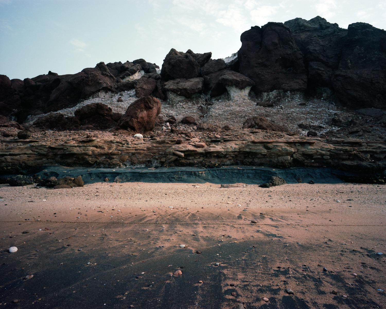 The presence of iron oxide creates unique soil pigments on the island of  Hormuz.