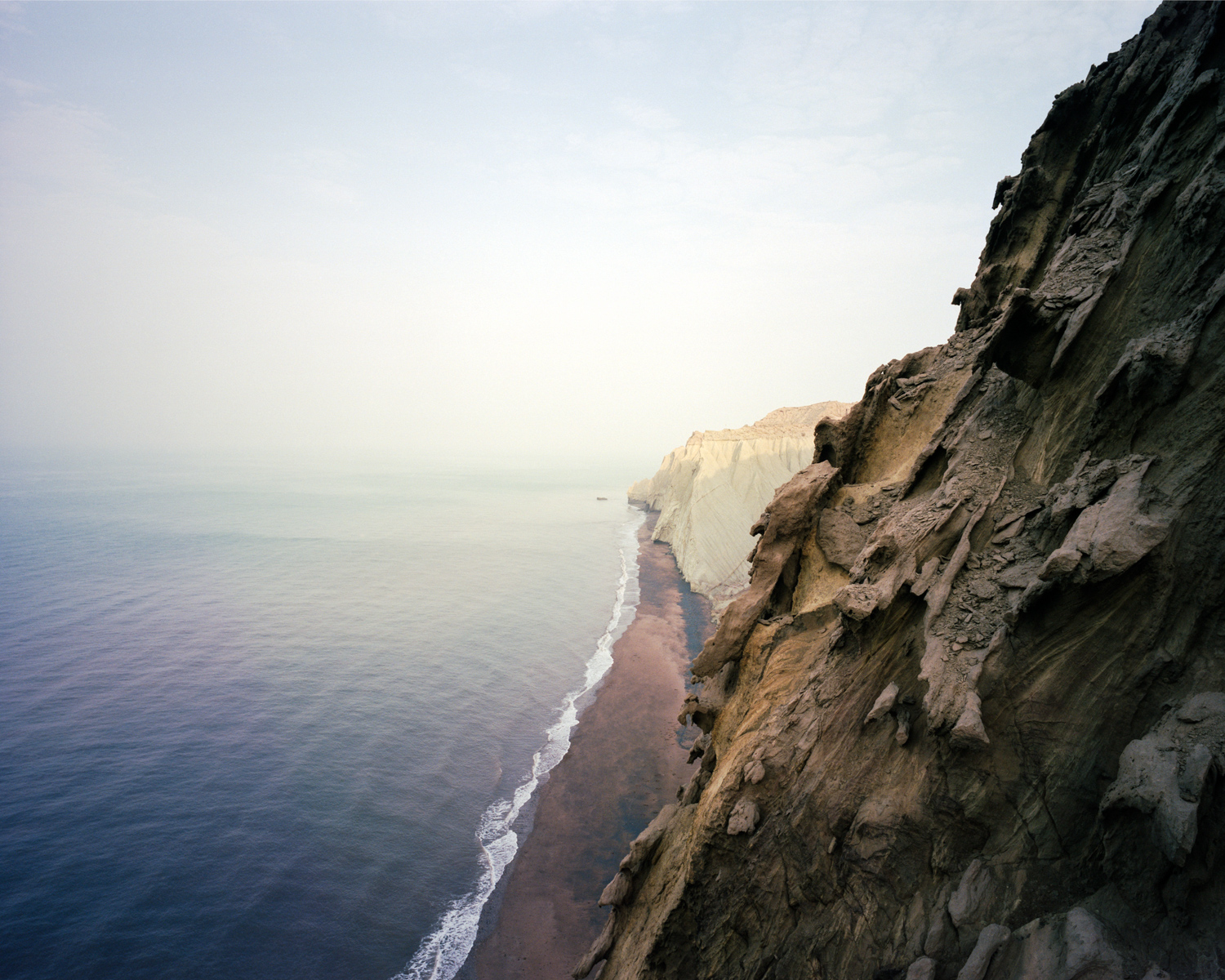 Caves & cliffs on the southern side of  Hormuz.