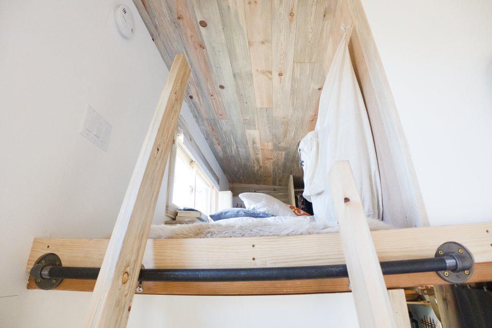 the-couple-climb-a-ladder-to-get-upstairs-to-the-bedroom.jpg