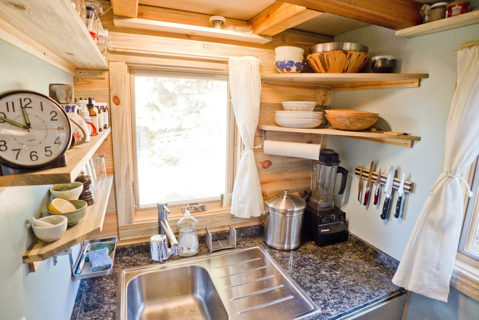 the-couple-have-access-to-pressured-city-water-which-simplifies-the-plumbing-process-shelves-help-them-find-room-for-all-their-ingredients-in-the-small-kitchen-area.jpg