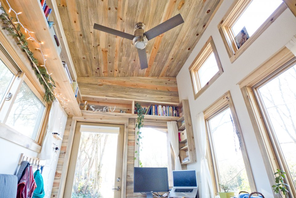 the-house-doesnt-feel-cramped-thanks-to-the-tall-13-foot-ceilings-theres-also-a-ceiling-fan-for-when-it-gets-hot-and-the-gorgeous-ceiling-was-made-from-sustainably-harvested-blue-stain-beetle-kill-pine.jpg