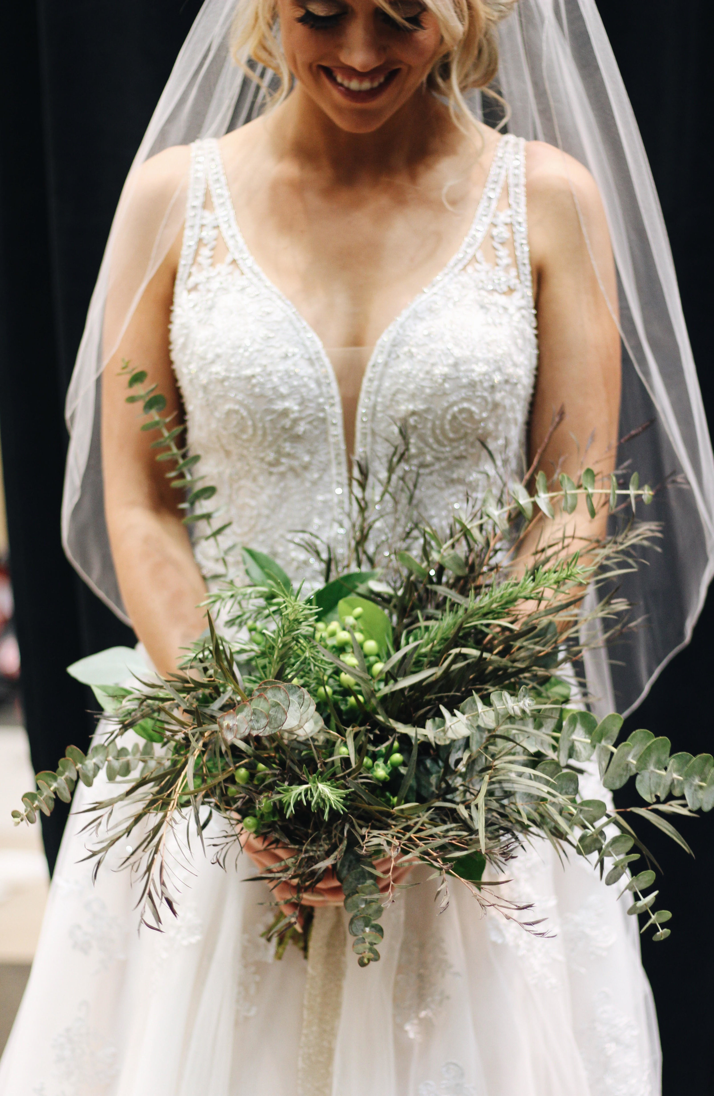 Bride holding flowers Wedding Bouquet by Blue Ivy Flowers, Chattanooga, TN