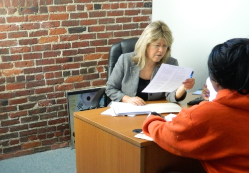 NSCAP Fonseca Foster Street office with client.JPG