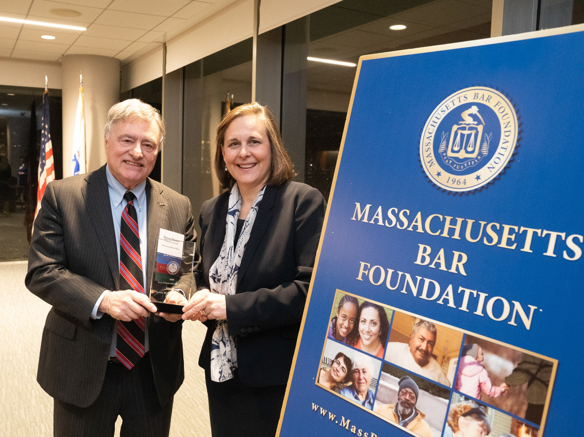 President Harvey Weiner presents Sue Finegan with the 2019 Great Friend of Justice Award