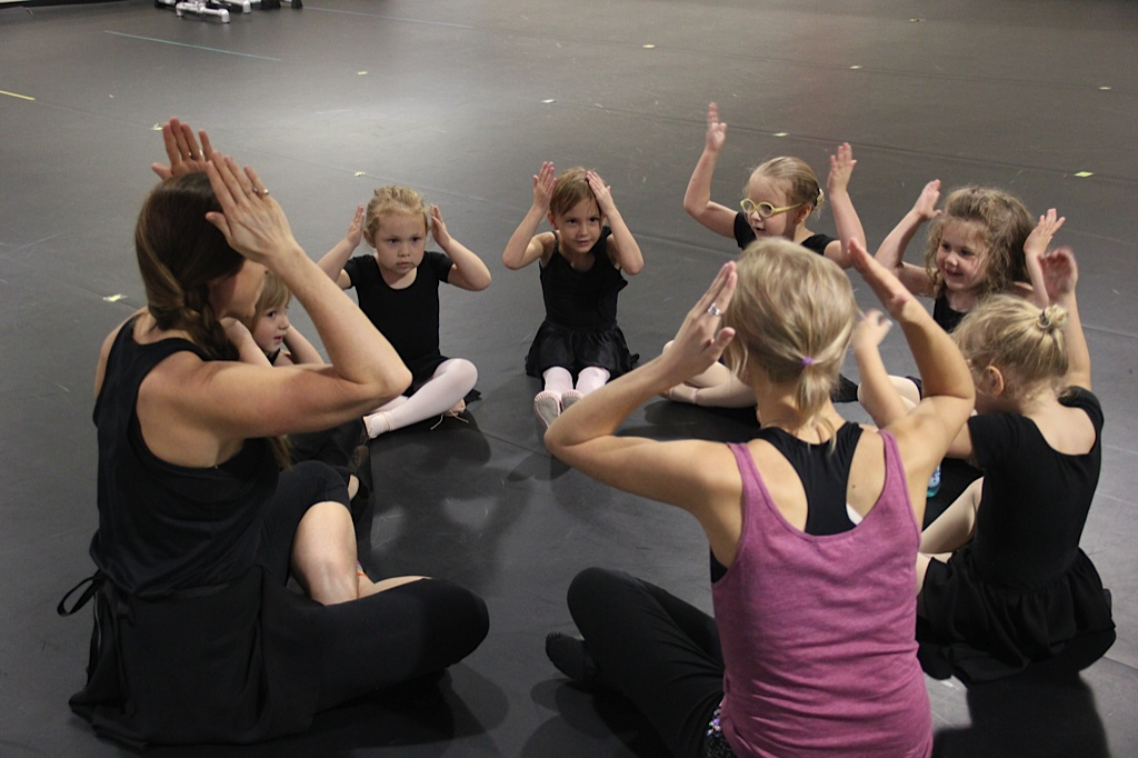 Class starts in Circle Time and dancers tap to the beat of the music.