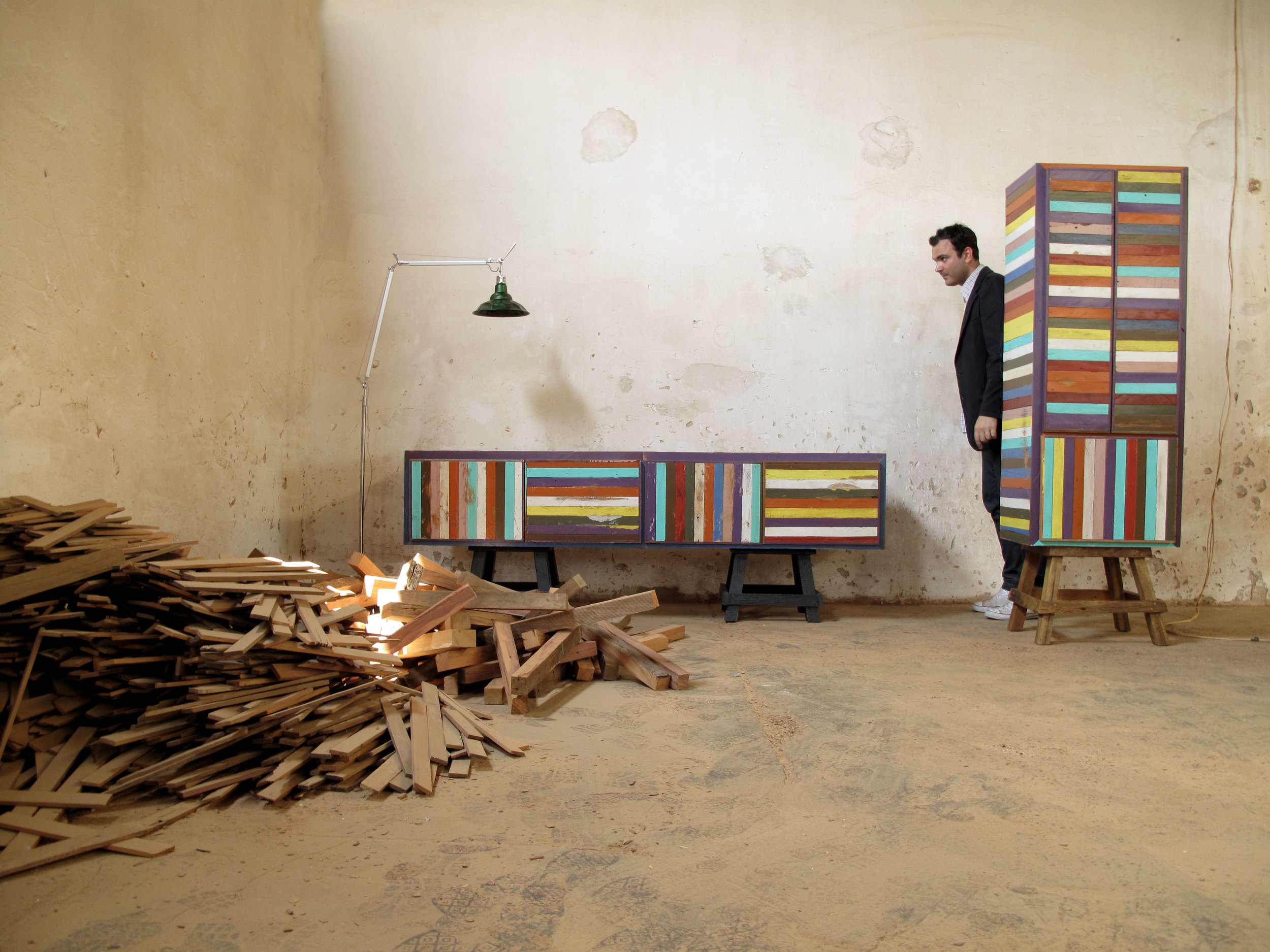 Press release image of Brunno Jahara among examples of Neorustica furniture