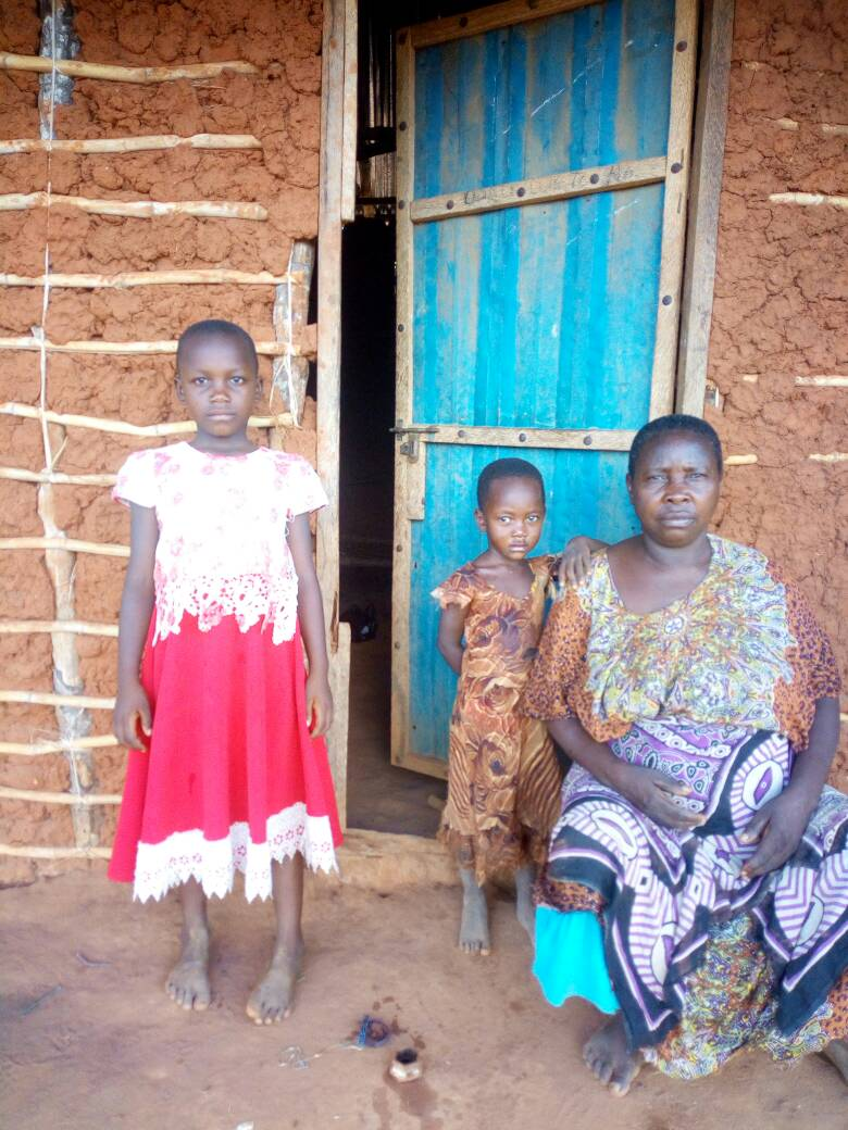 Waridi with her sister and their grandmother.