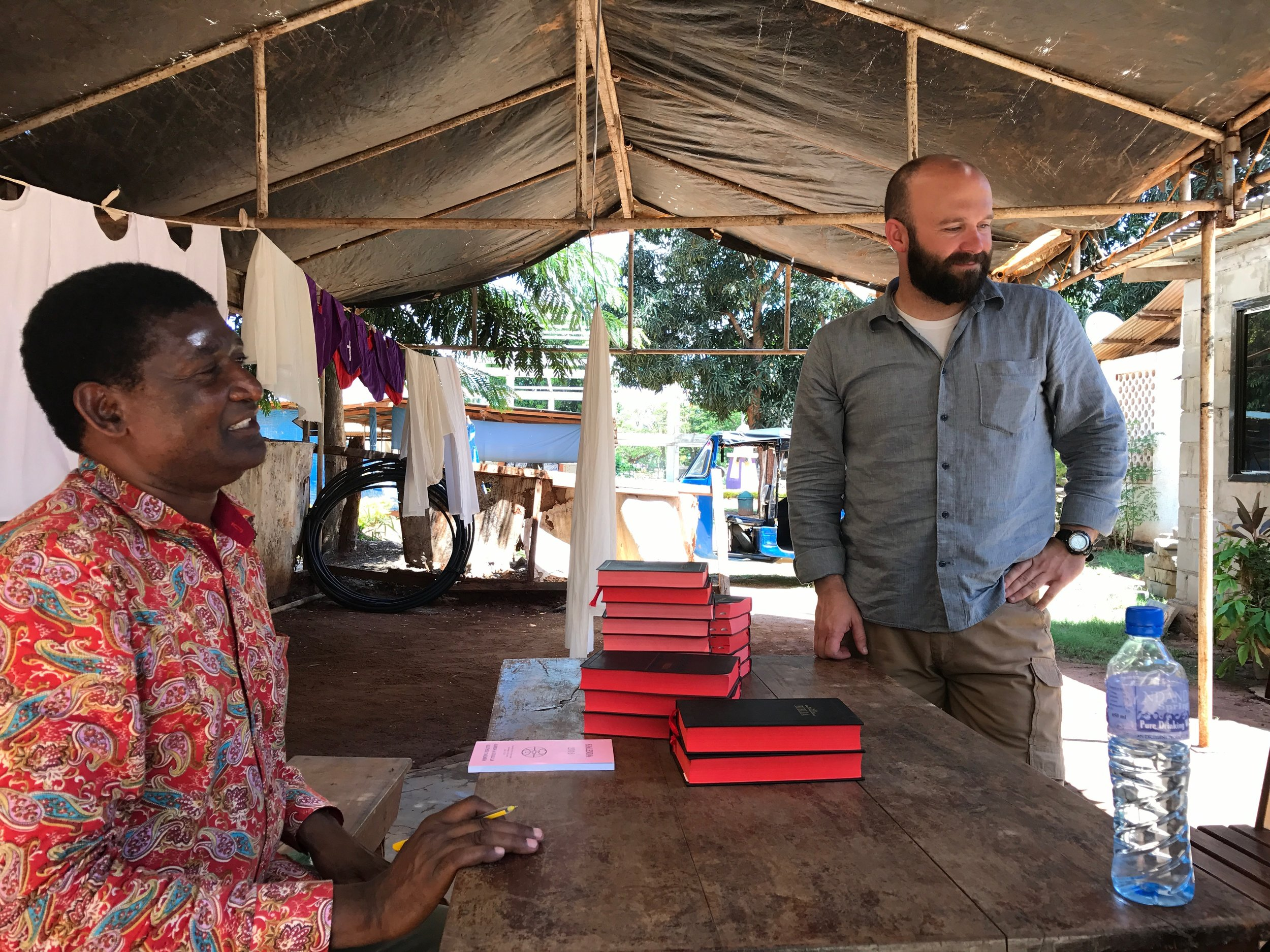 Pastor Frank helps Dillon purchase Bibles to send to Nanguruwe.