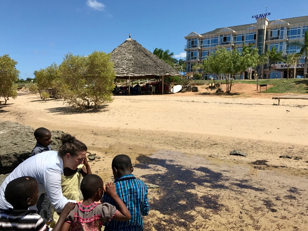 Exploring the tide pools near the thatch roof restaurant at the NAF Beach Hotel.