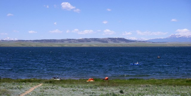 Float tubers and light water craft head to shore when the wind kicks up on Spinney Mountain Reservoir.