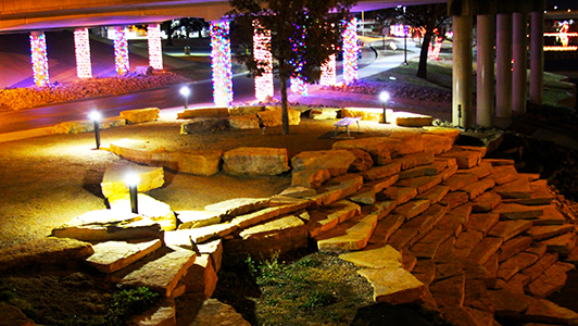 COMPLETED PLAZA NEXT TO 87S BRIDGE - AT NIGHT