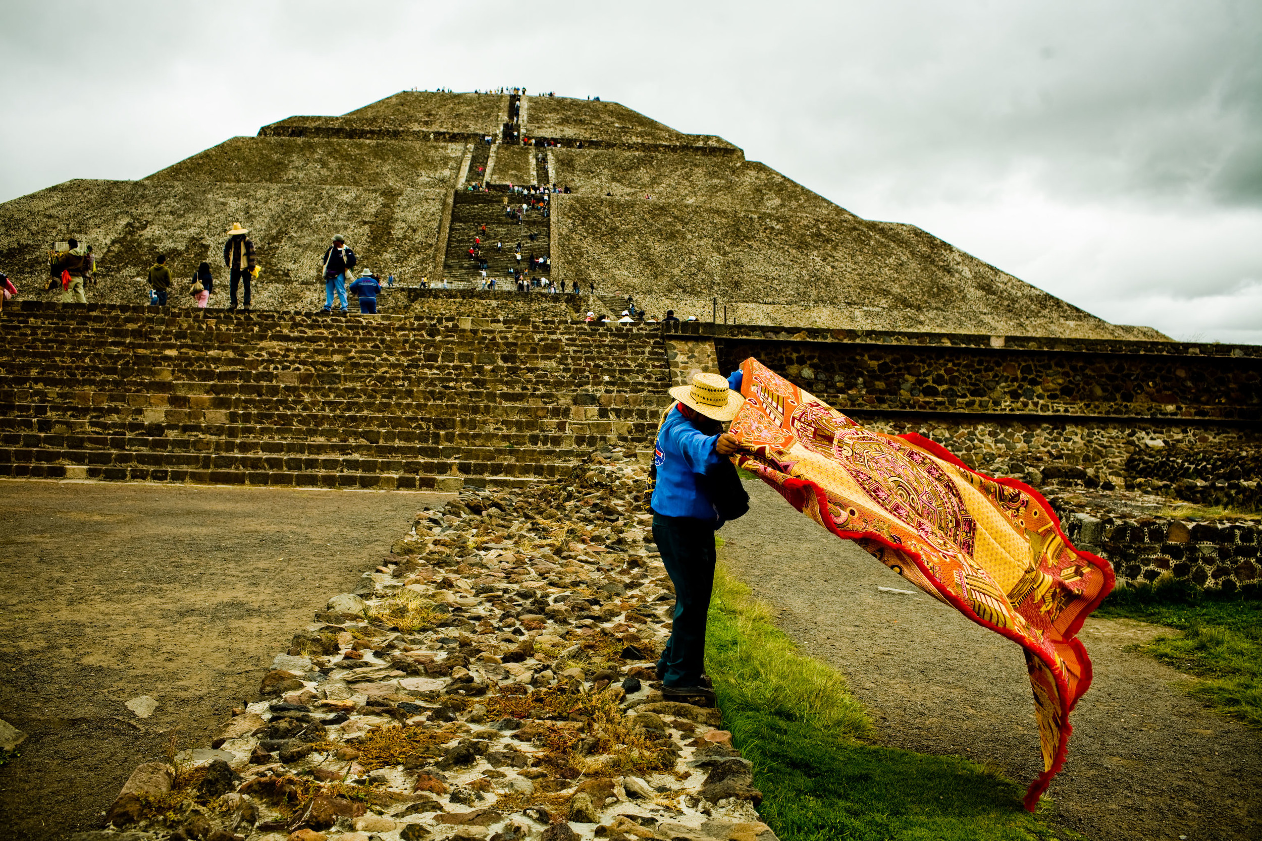 A man displays a rug for sale at the ruins of Teotihuacan, near Mexico City, Mexico.