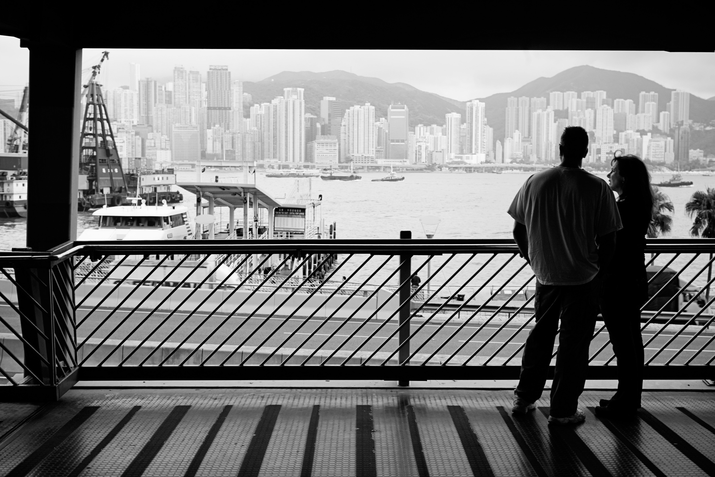 Karen and Bob share a quiet moment by the Hong Kong waterfront. The next day is Karen's 50th birthday, and they will fly to Nanchang, China to meet their daughter for the first time.