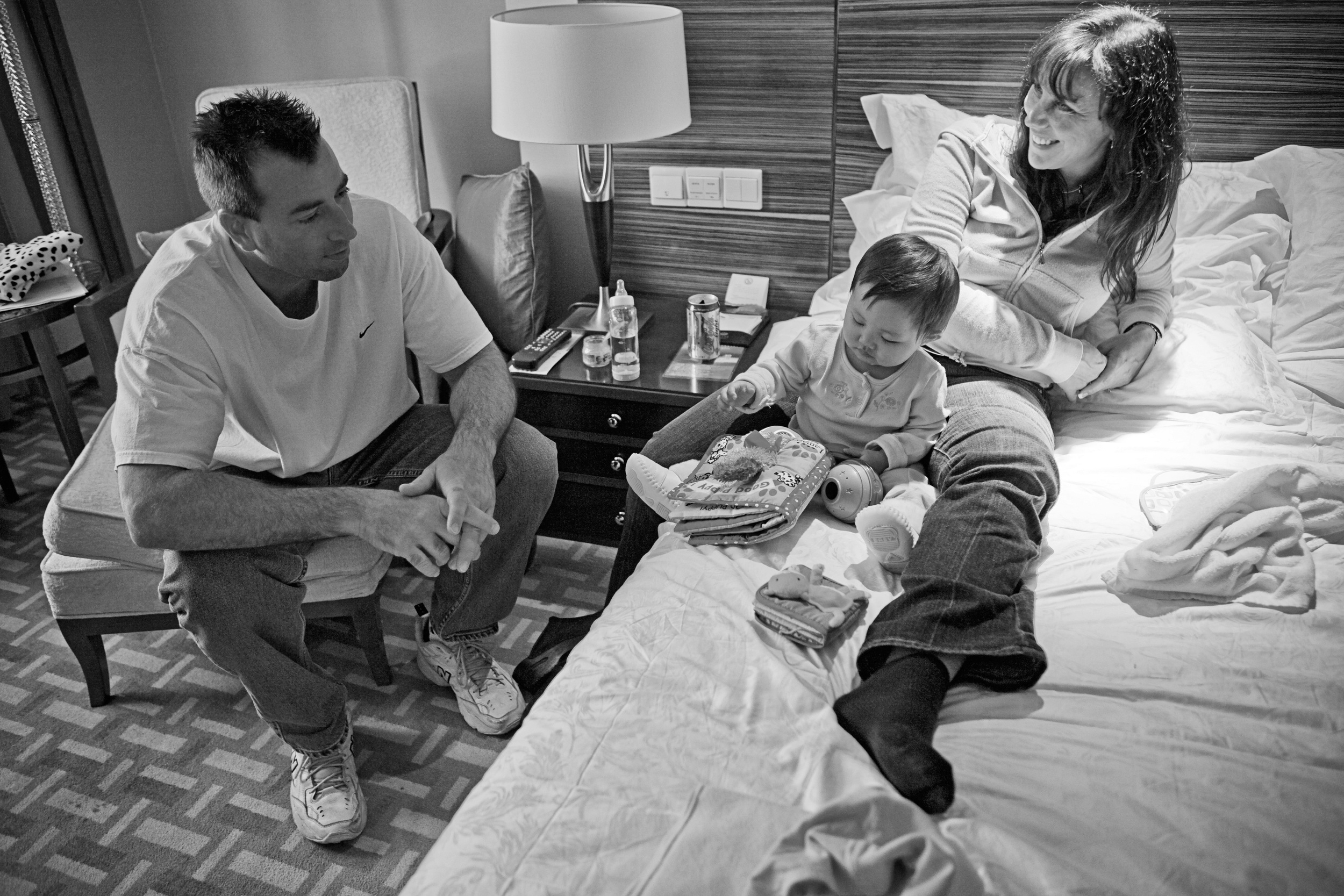 Bob, Karen and Kailee share time together in the hotel room.