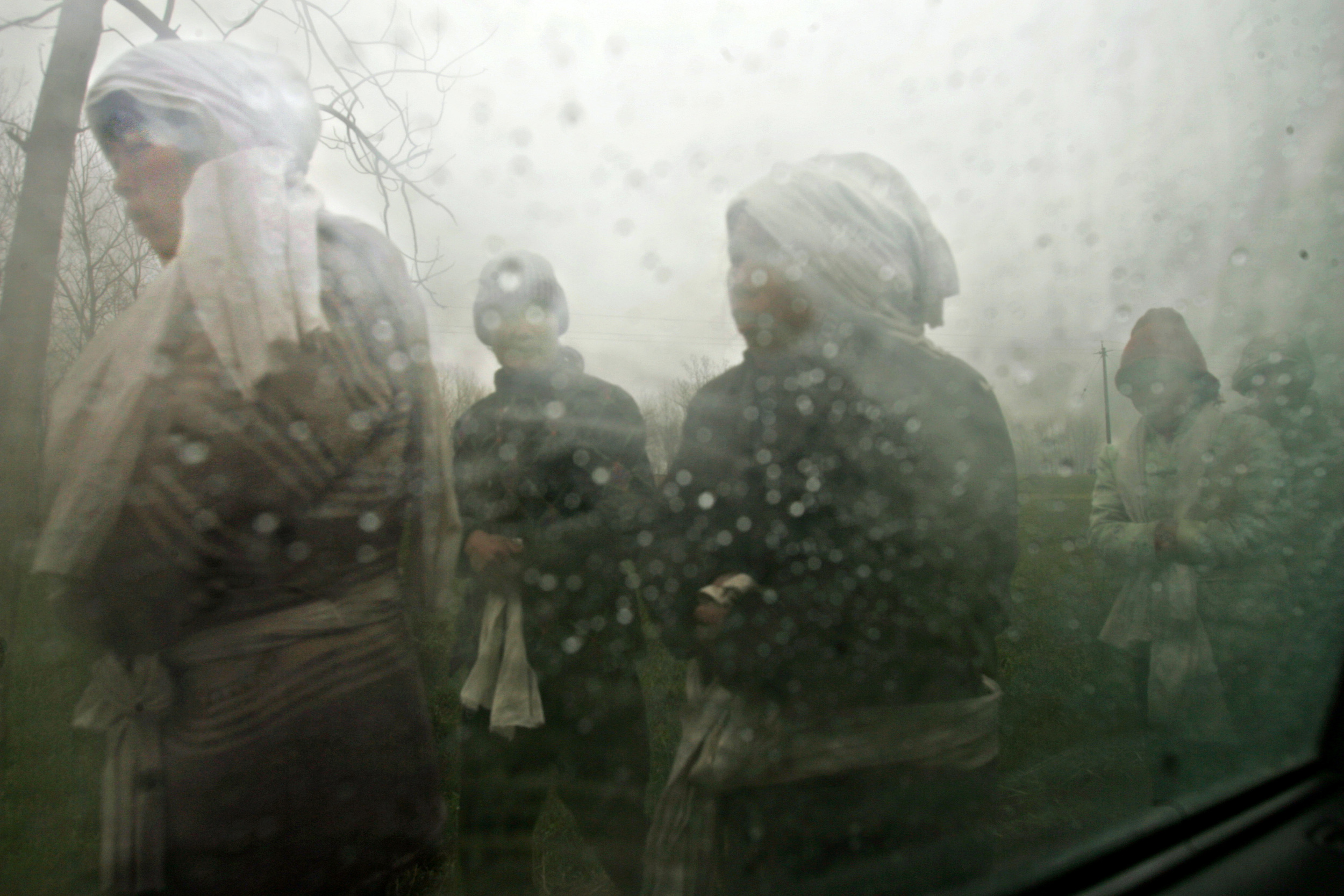 Villagers in Shenqiu County return from a funeral.