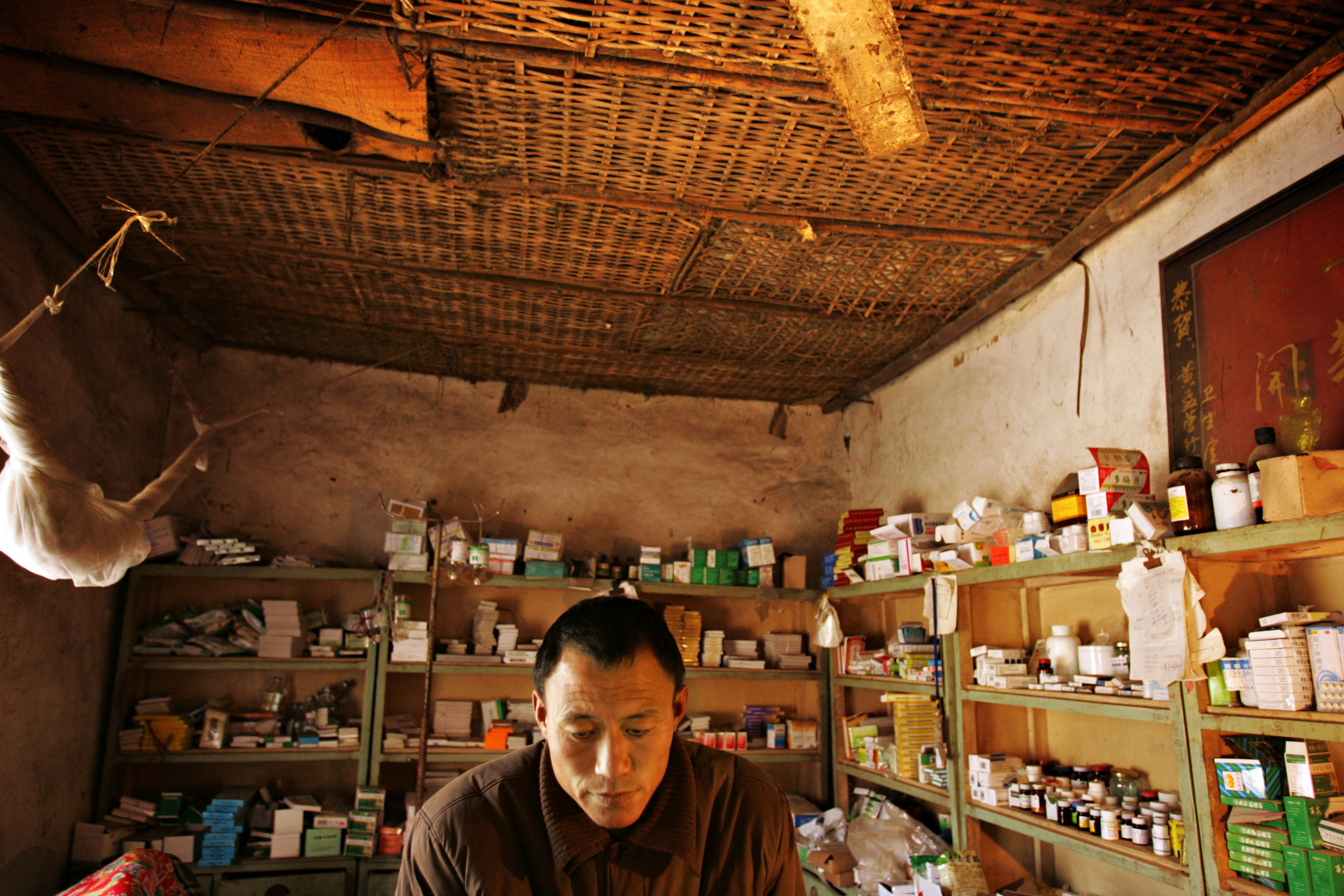 Wang Shiweu, 42, is an accountant by training, and operates the medical clinic in Huangmengying. He dispenses traditional Chinese medicine to villagers, most of whom are no longer able to afford conventional treatment for cancer.