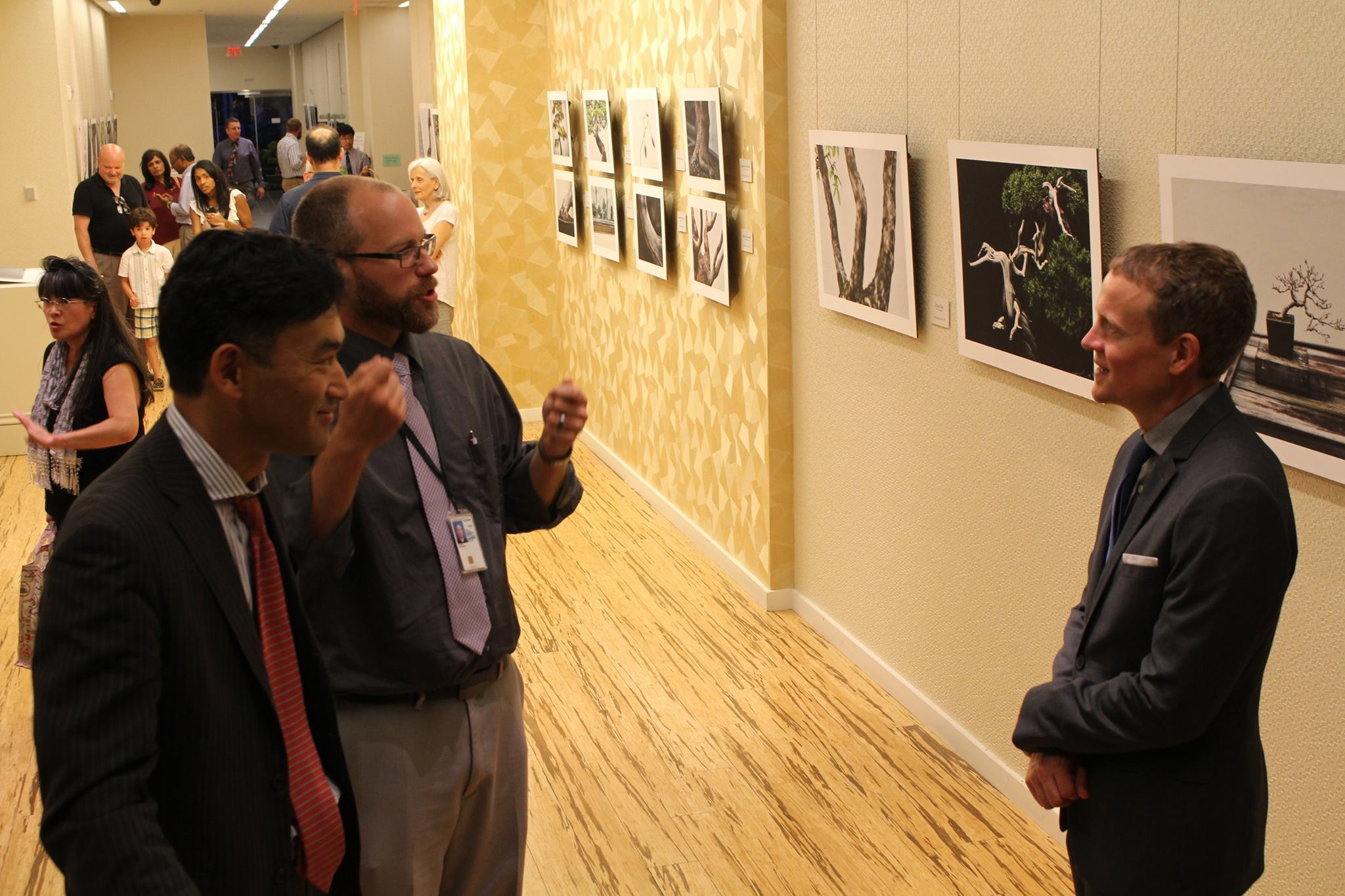 Speaking with attendees at the JICC exhibit opening.