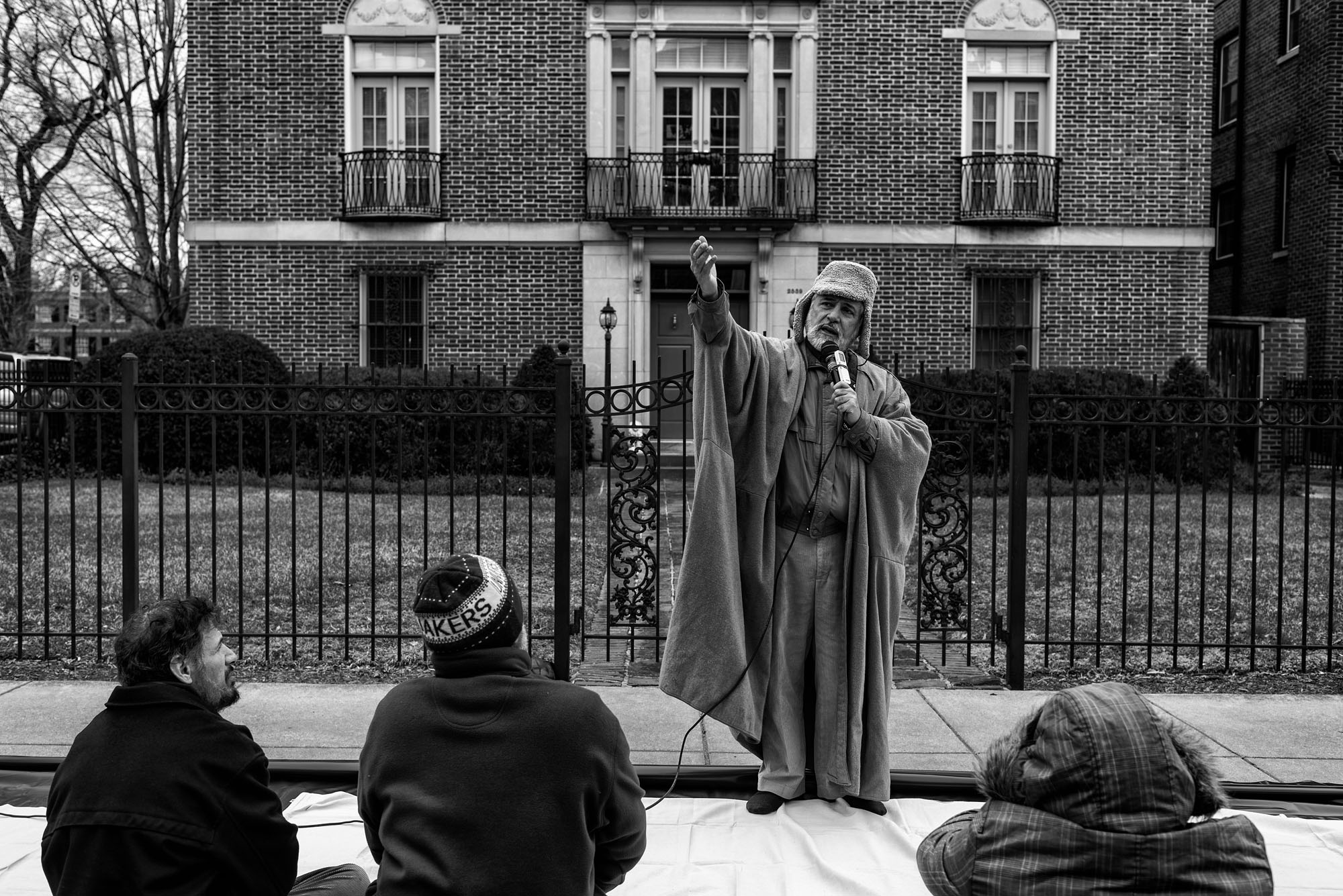 Imam al-Asi leads a group in prayers outside the Islamic Center of Washington on February 3, 2017.