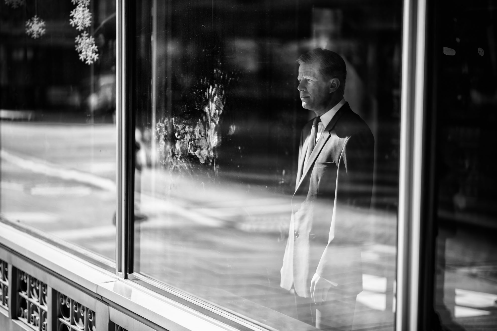 A wax figure of President John F. Kennedy faces out a window in downtown DC on February 6, 2017.