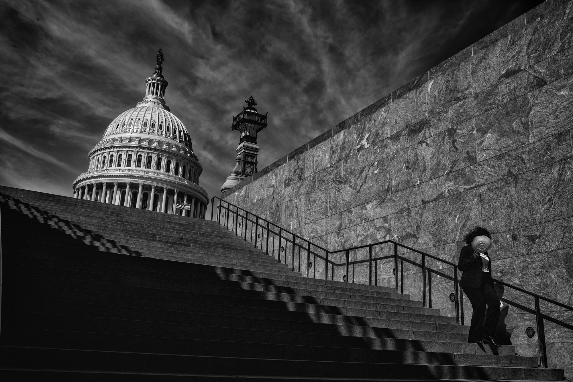 A woman walks down the stairs near the US Capitol Visitor's Center, on February 24, 2017.