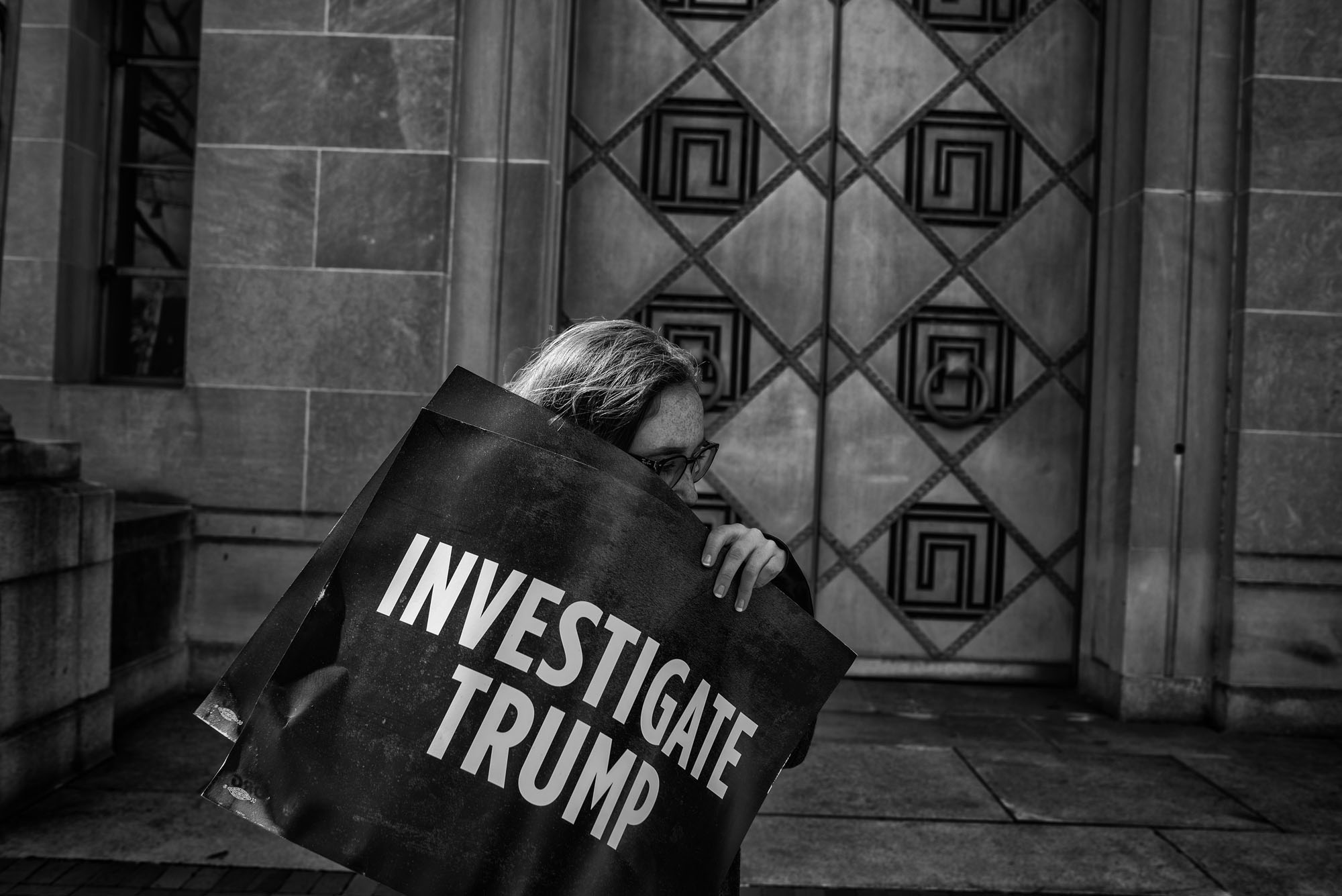 A protester outside the US Department of Justic demanding Attorney General Jeff Sessions recuse himself from any investigations into Russia, on March 2, 2017.