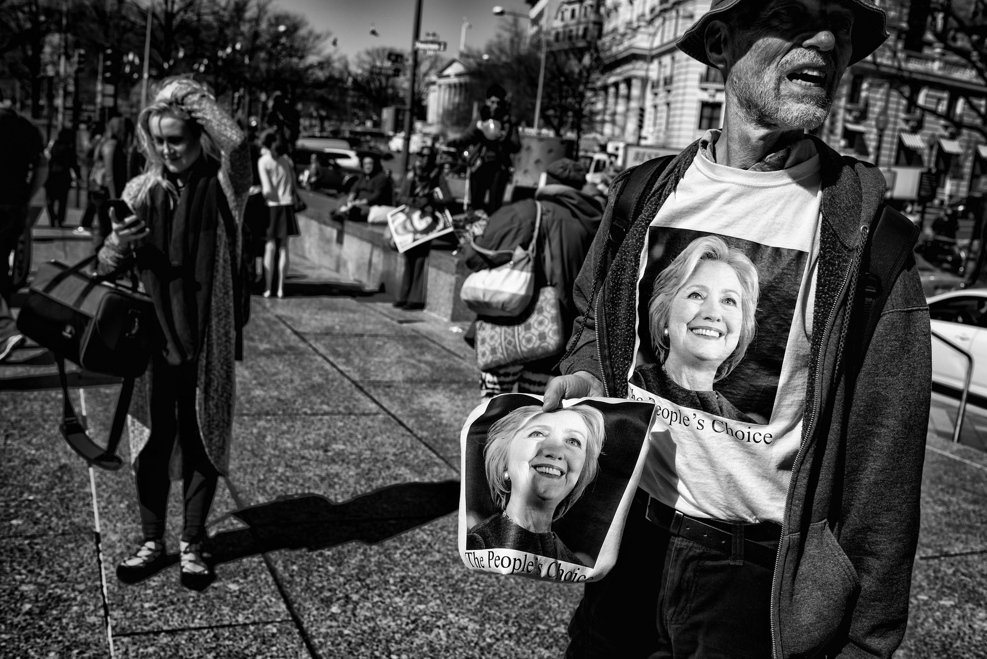 A man sells Hillary Clinton t-shirts at the Day Without Women protest in Washington, DC on March 8, 2017.