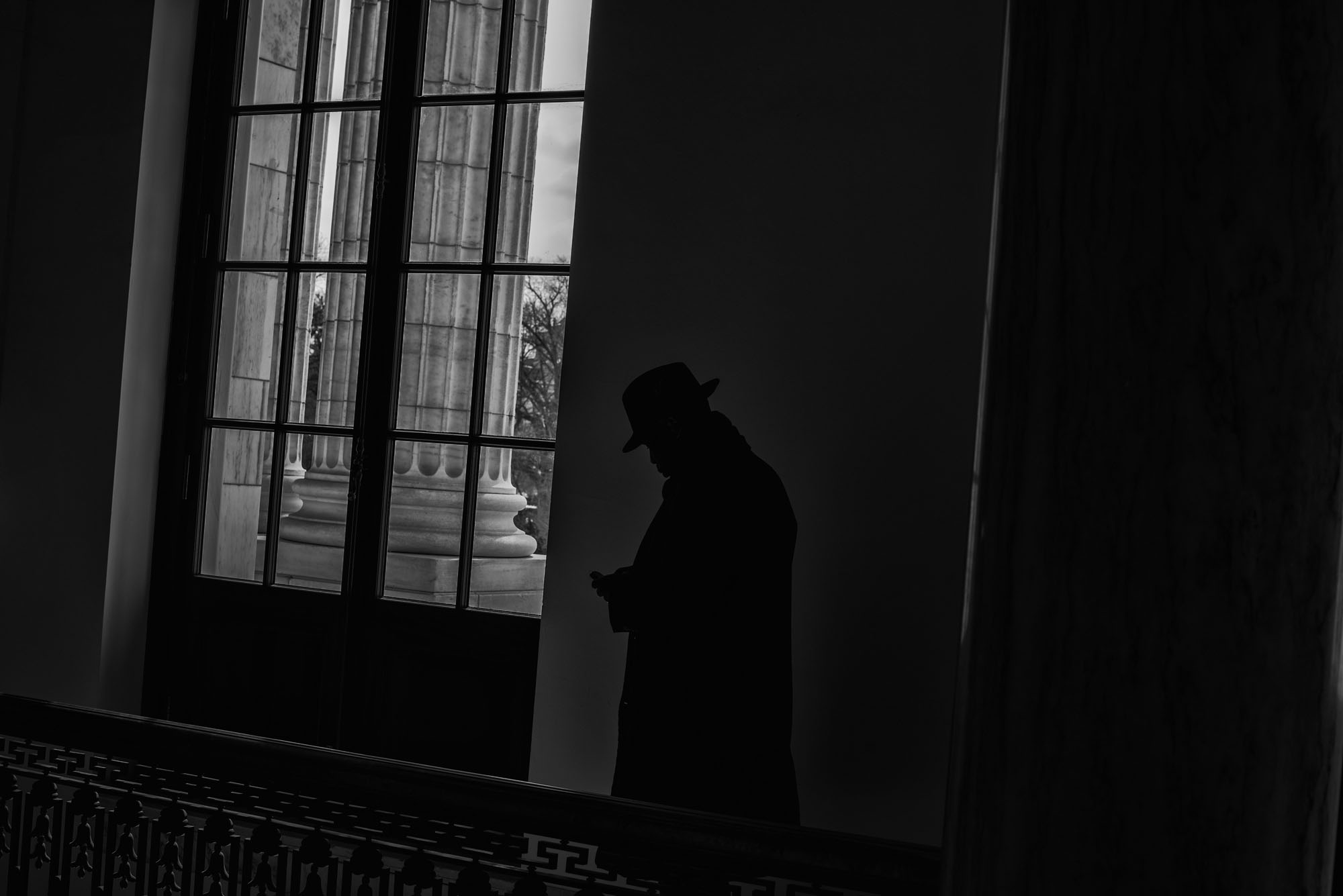 A man checks his cell phone in the US Capitol on March 15, 2017.