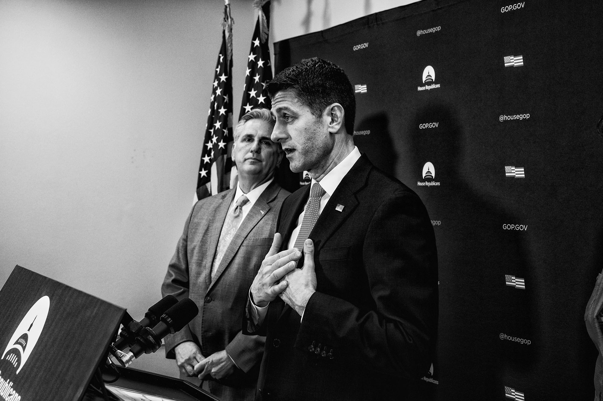 House Majority Leader Kevin McCarthy listens to House Speaker Paul Ryan speak to the media during a briefing after attending a closed House Republican conference on March 28, 2017