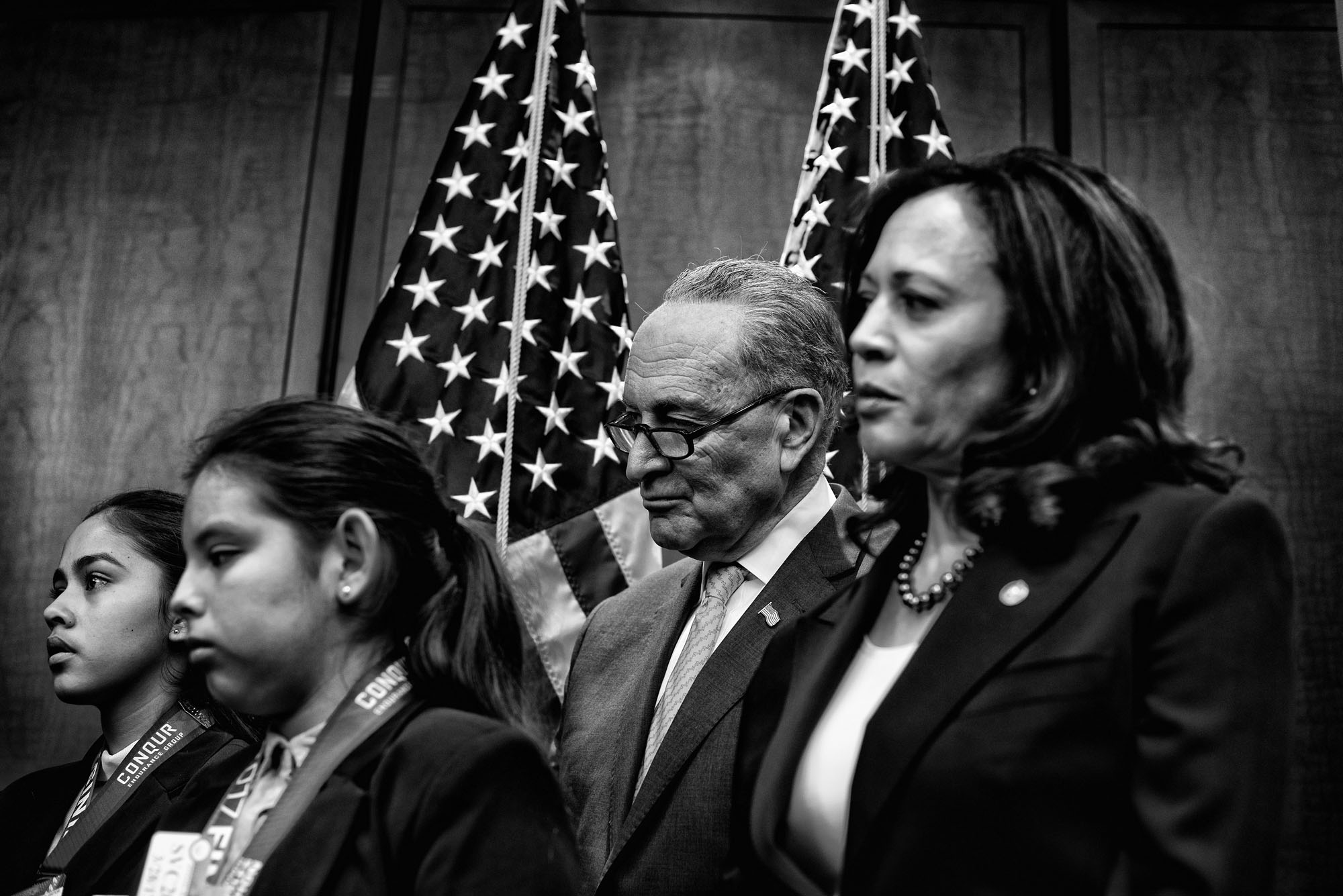 Senator Chuck Schumer listens to speakers during a news conference organized by La Raza highlighted the deportation of illegal immigrants and its effects on families.