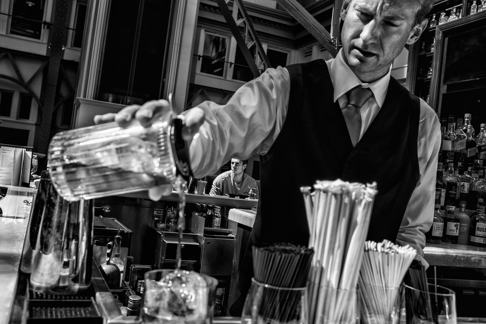 A bartender pours a drink at the Benjamin Bar & Lounge, located in the Trump International Hotel on March 29, 2017.