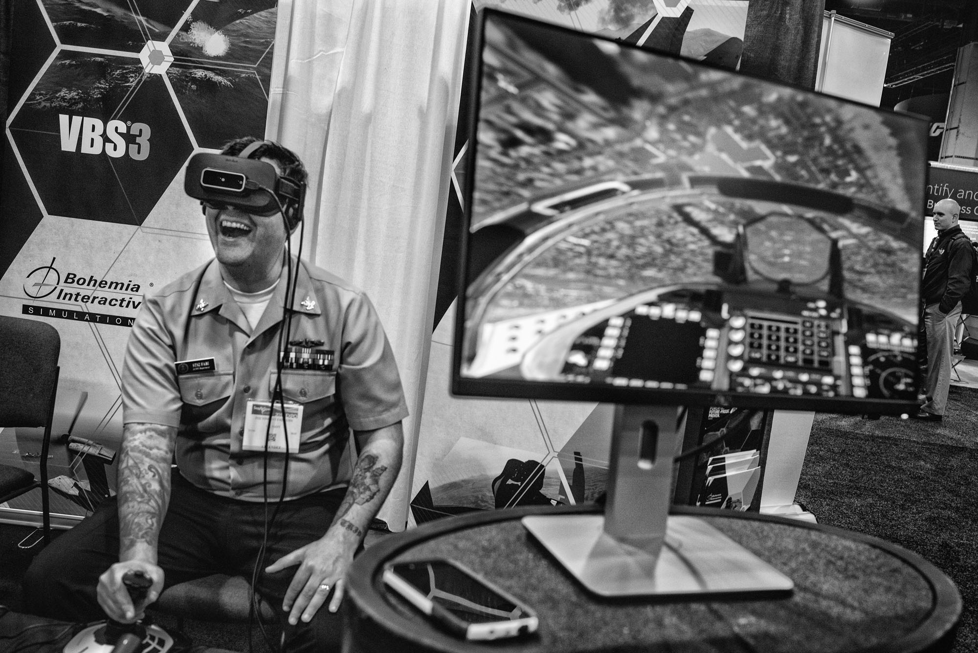 An attendee tries a virtual reality headset at The Navy League's Sea-Air-Space Exposition in National Harbor, Maryland on April 3, 2017. The Trump Administration's proposed budget would increase military spending by 10%, or $54 billion in the coming fiscal year.
