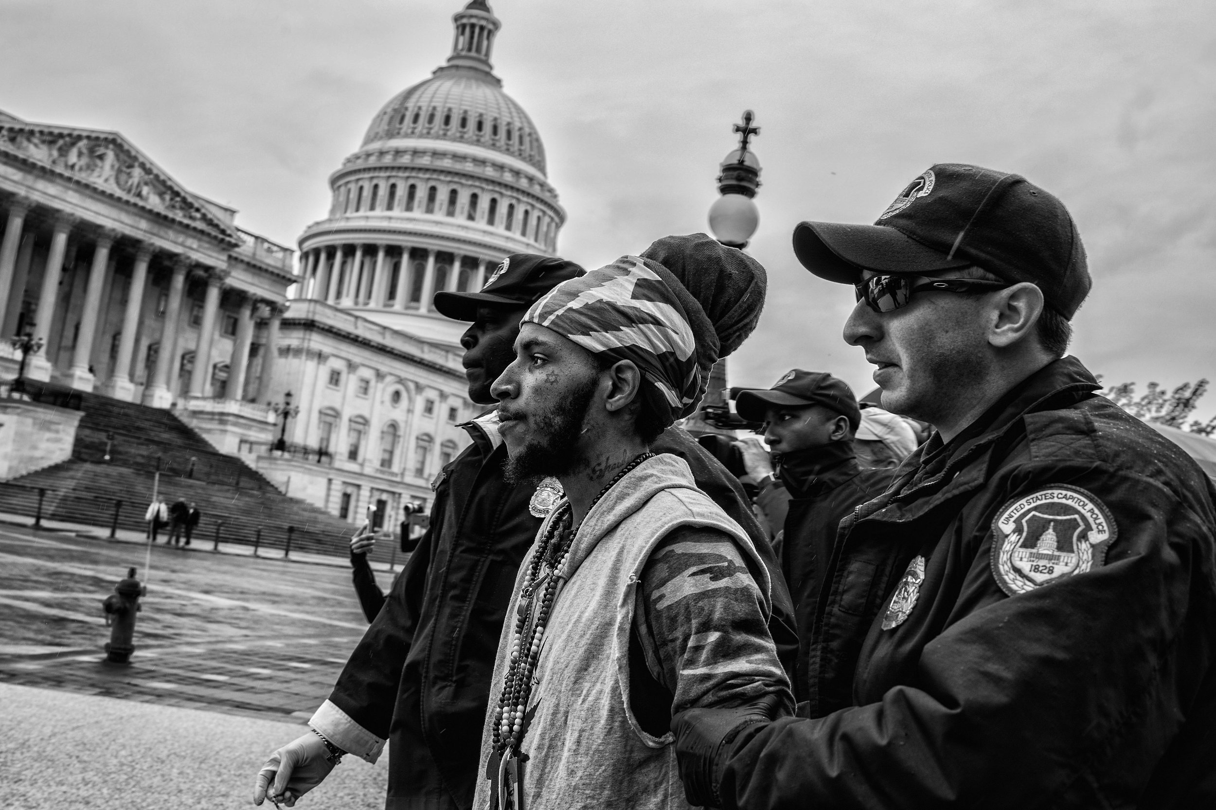Day 95 : Jerome Waite known as Rasfia is arrested after lighting a marijuana joint at a pro-cannabis rally on Capitol Hill on April 24, 2017.