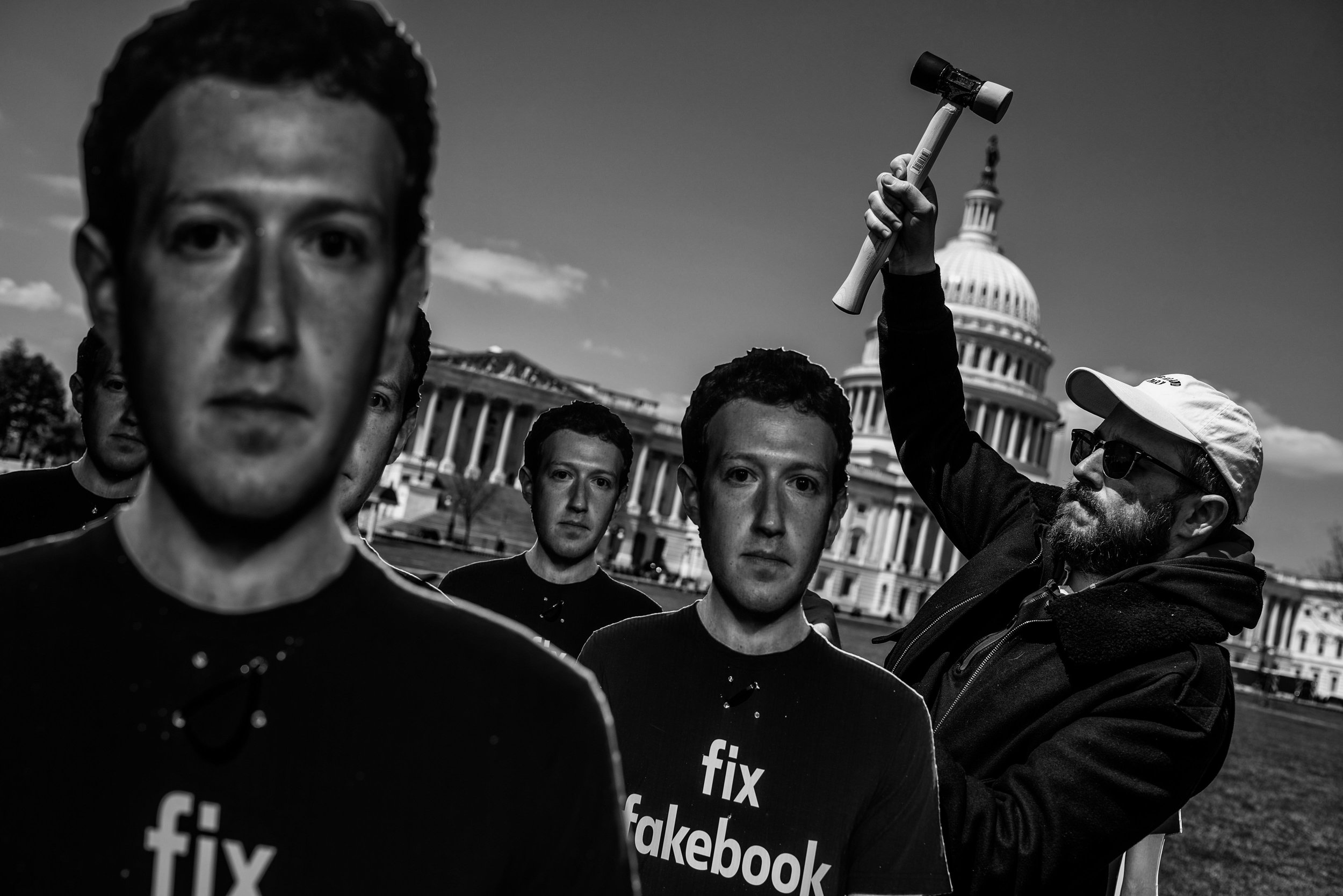 Day 446: Will Davies, a campaigner for Avaaz secures a cardboard cut-out of Facebook CEO Mark Zuckerberg on the south east lawn of the US Capitol, in Washington, DC on Tuesday, April 10, 2018.