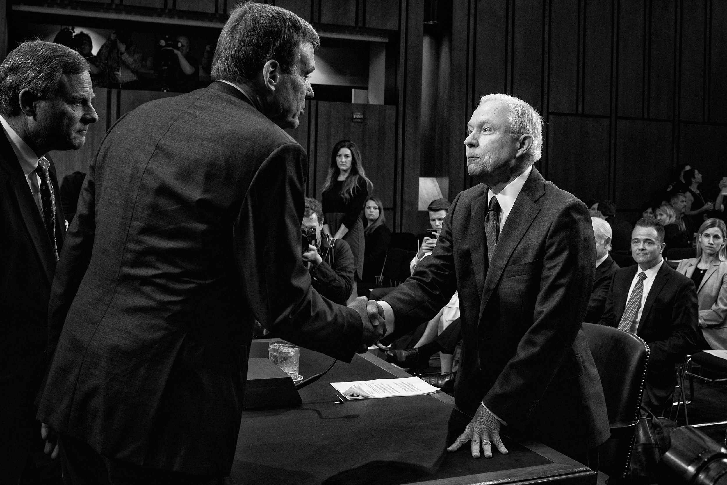 Day 145: Attorney General Jeff Sessions shakes hands with Senator Mark Warner before the Senate Intelligence Committee at the Hart Senate Office Building in Washington, DC on June 13, 2017.