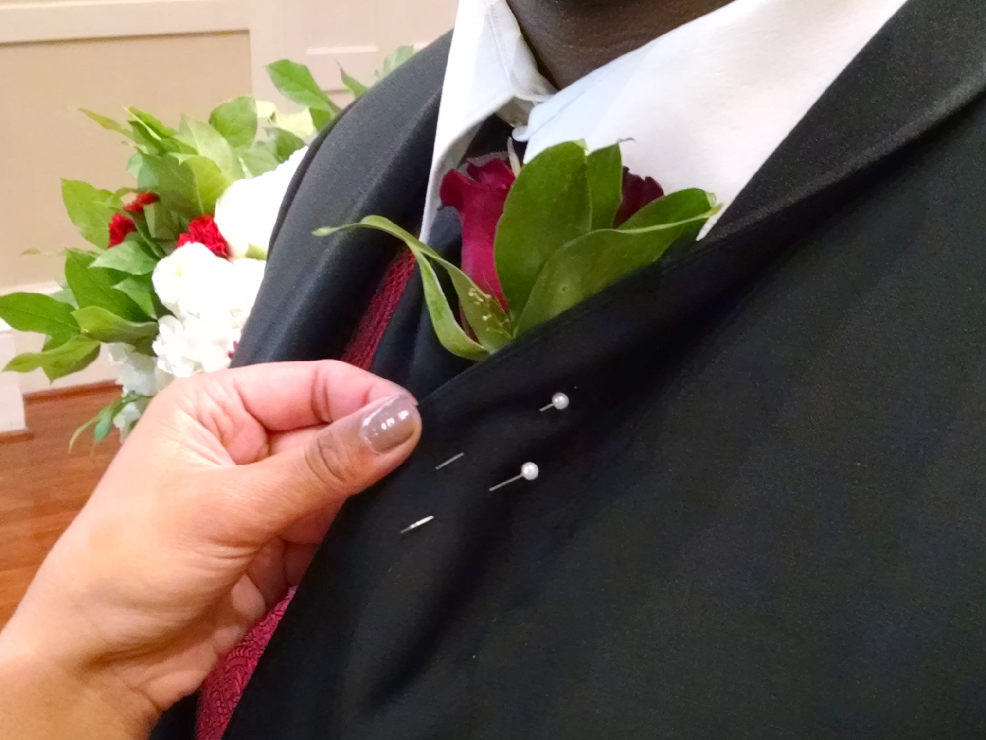 Boom!  Two pins through the lapel, stem, and back through the lapel.  All without stabbing anyone!