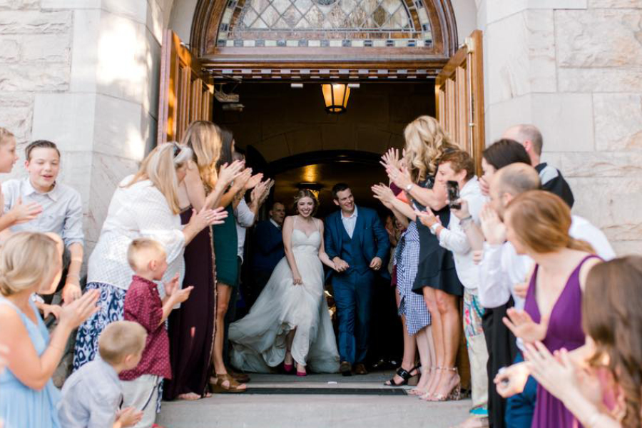 Bride and groom just married bursting out of a church, stone church, happy couple, Gig Harbor wedding venue, Events on 6th, Photo by Ink and Grain