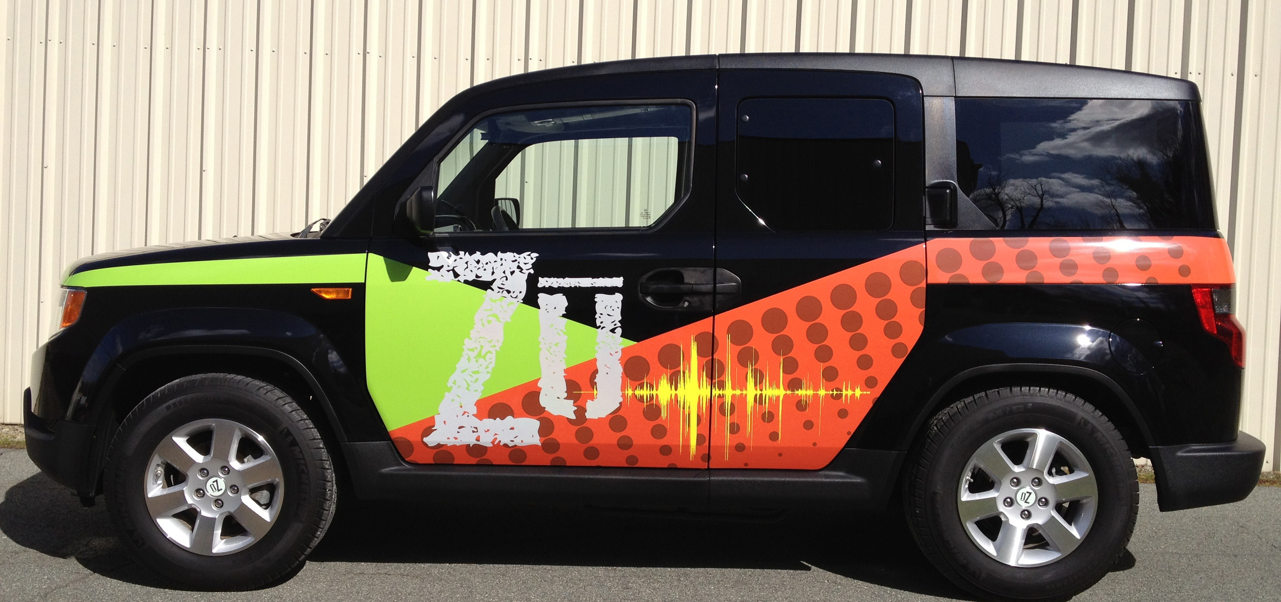 DECALS AND VINYL STICKERS In need of a promotional vehicle for your business? We take cars and boats to the next level with our graphics services. We also apply full custom wraps for businesses and vinyl stickers for heavy equipment such as tractors.
