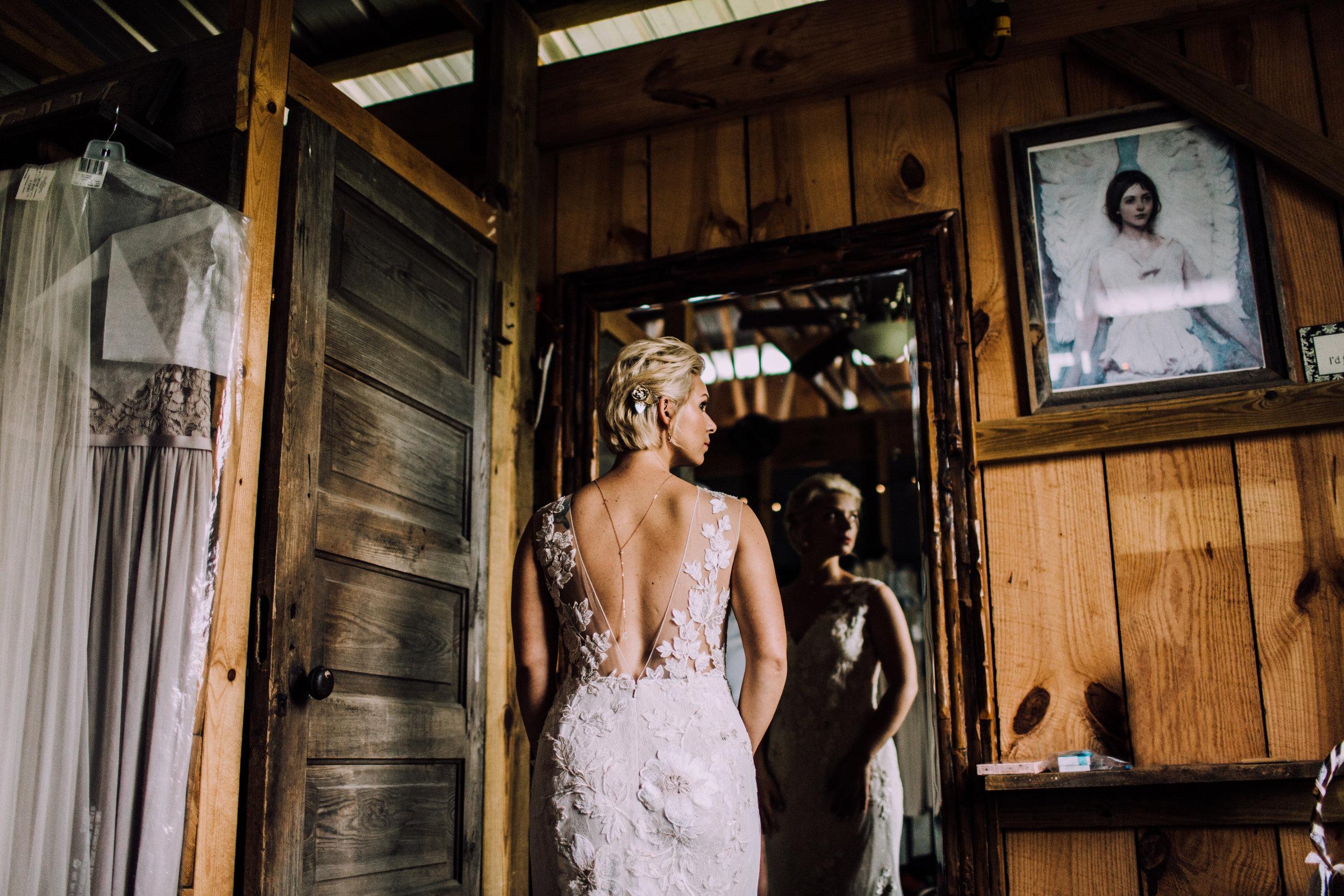 bride in mirror reflection barn at drewia hill wedding