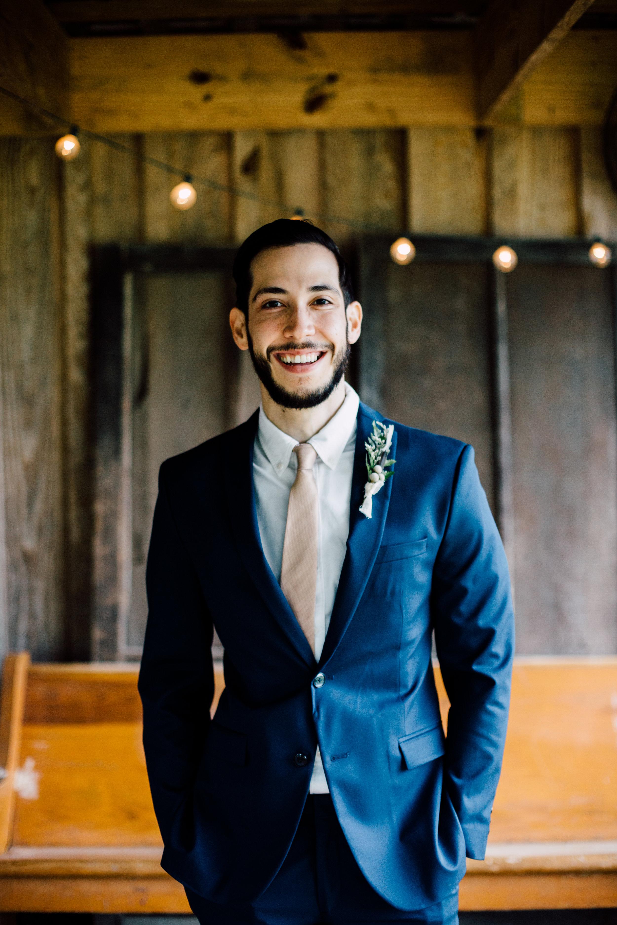 smiling groom zara navy blue suit
