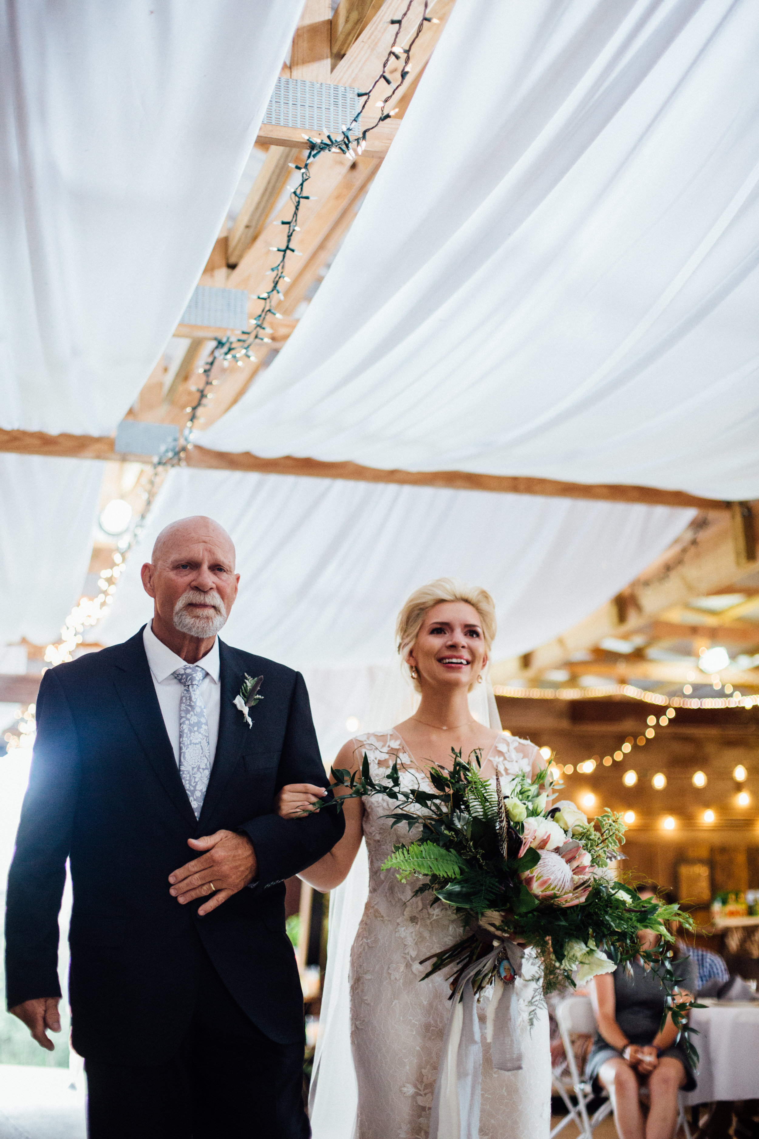 bride walks down the aisle crying