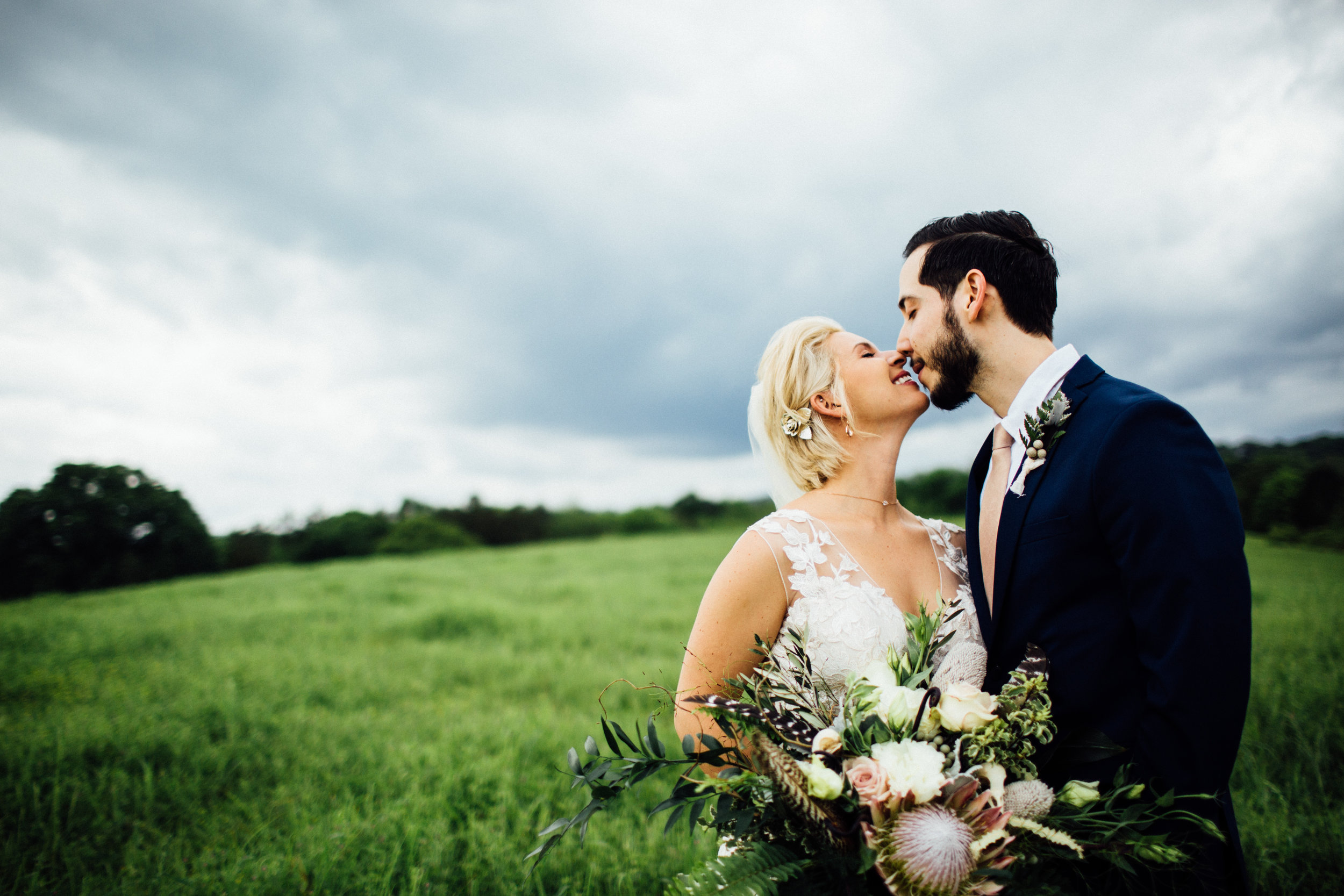 bride and groom couple portraits in field