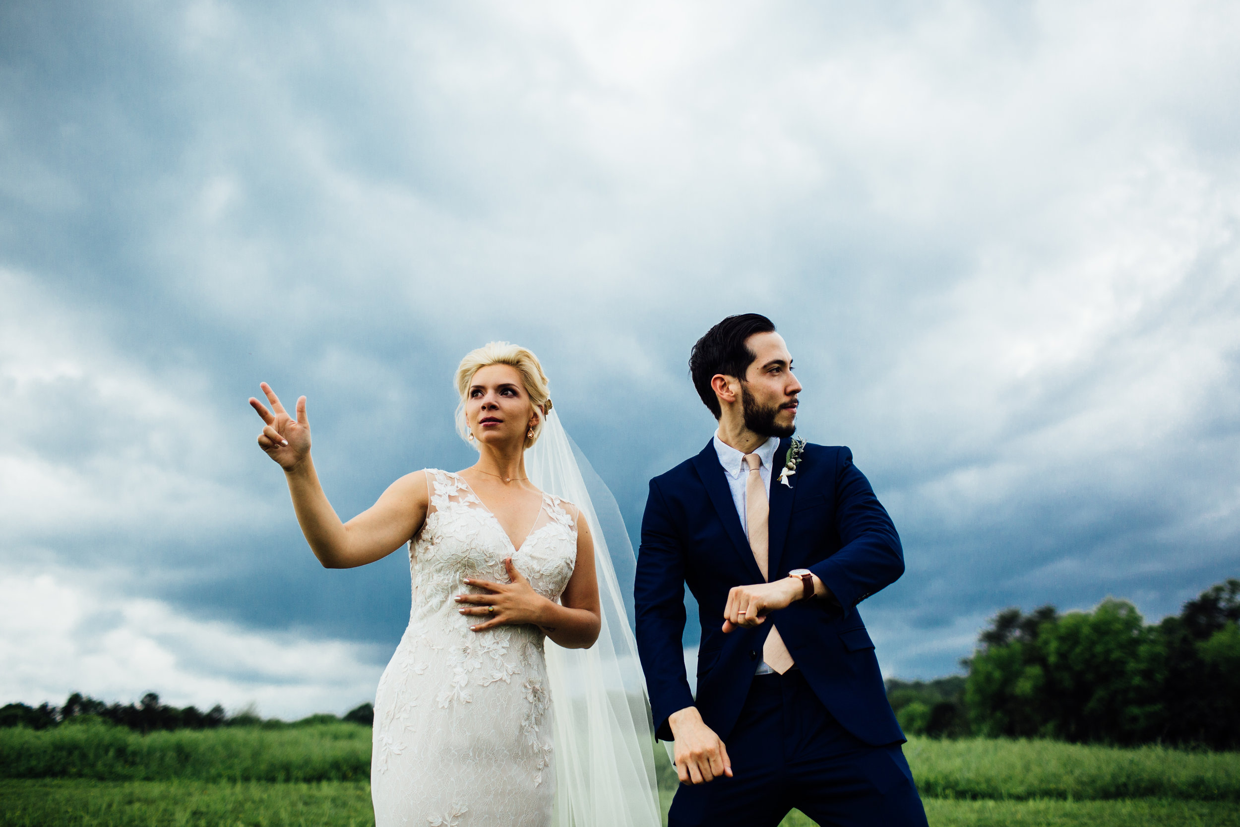 bride and groom fun dance moves stormy sky