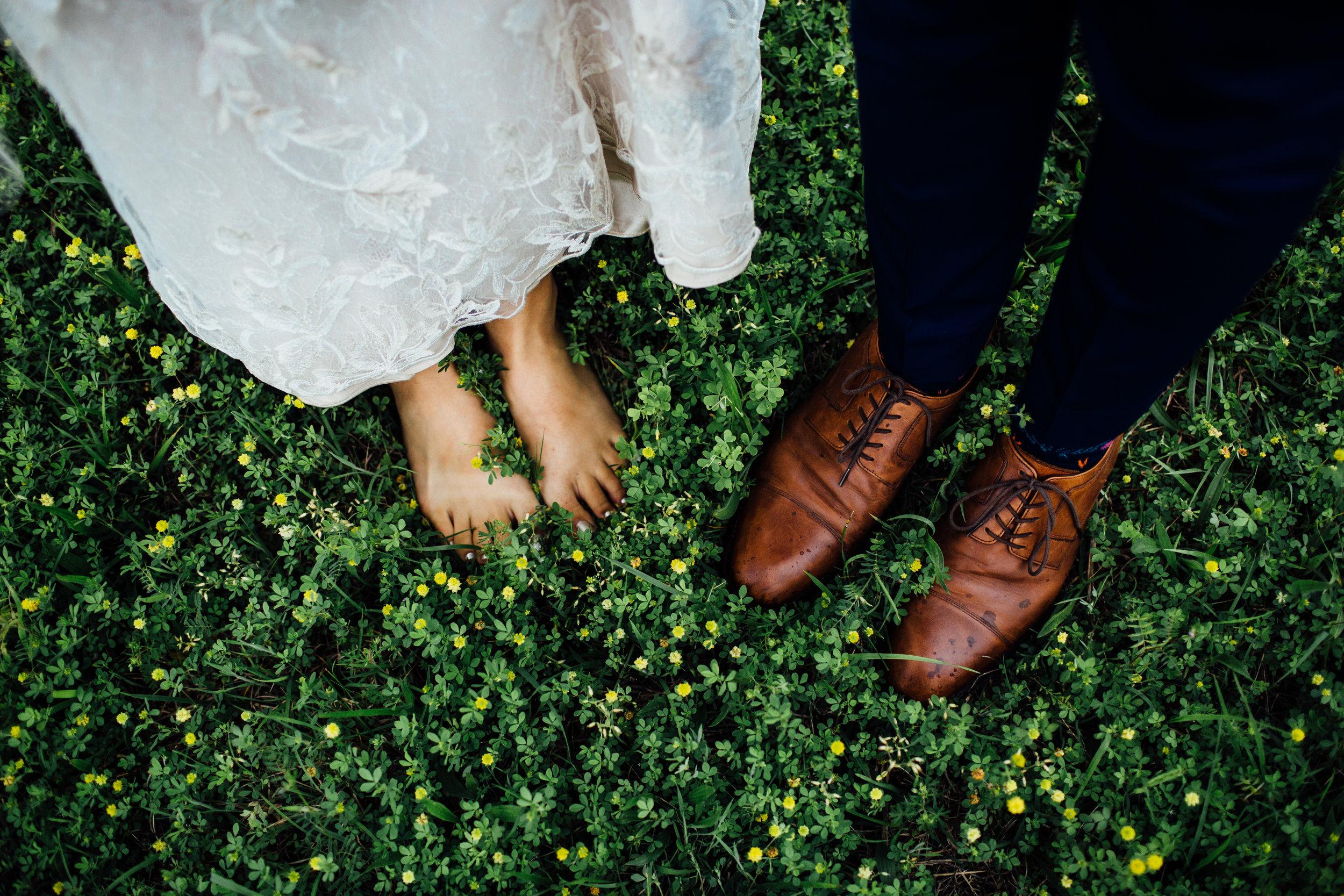 feet in the grass little flowers