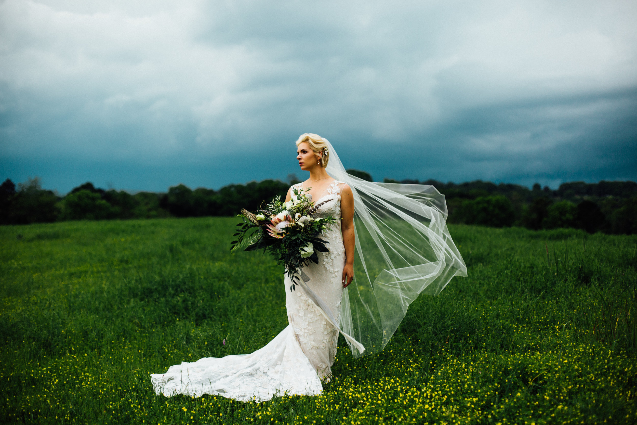 stormy dramatic bride portrait veil blowing in the wind