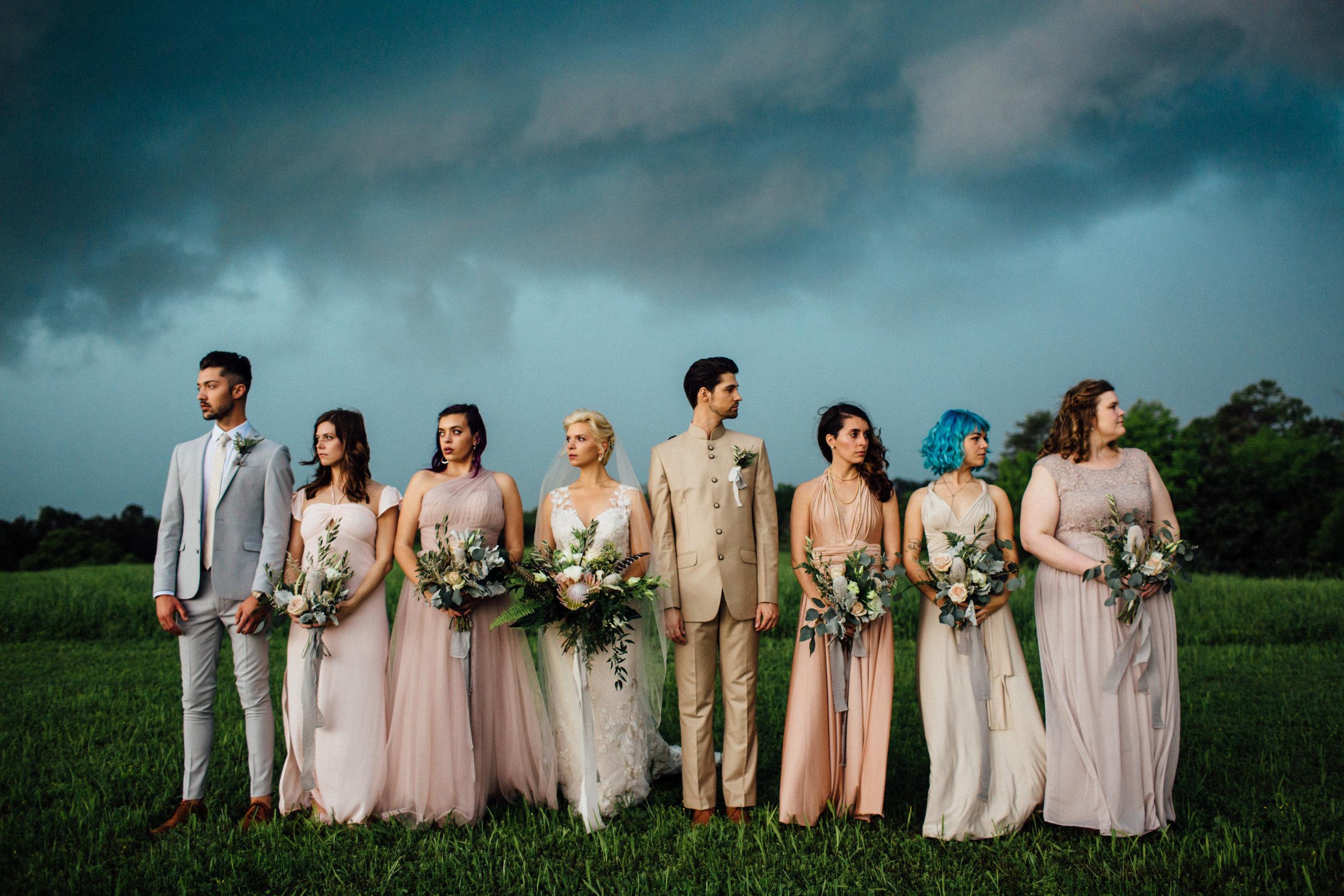 stormy bridesmaids portrait windy pastels