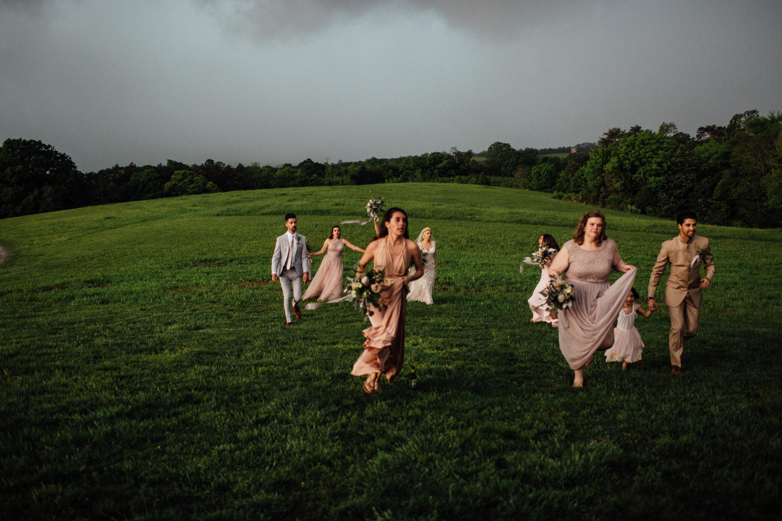 bridesmaids running from storm