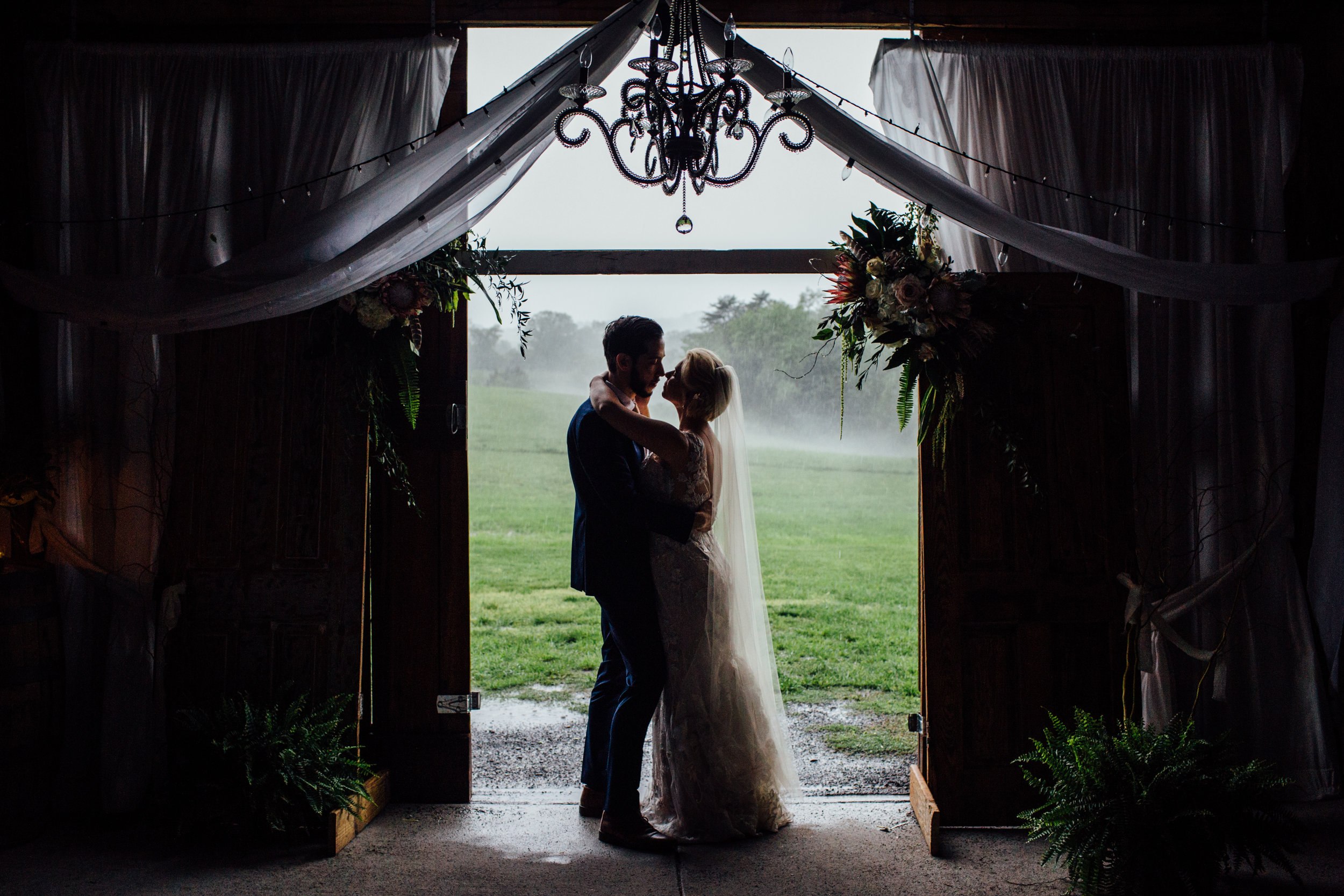 bride and groom silhouette inside barn at drewia hil