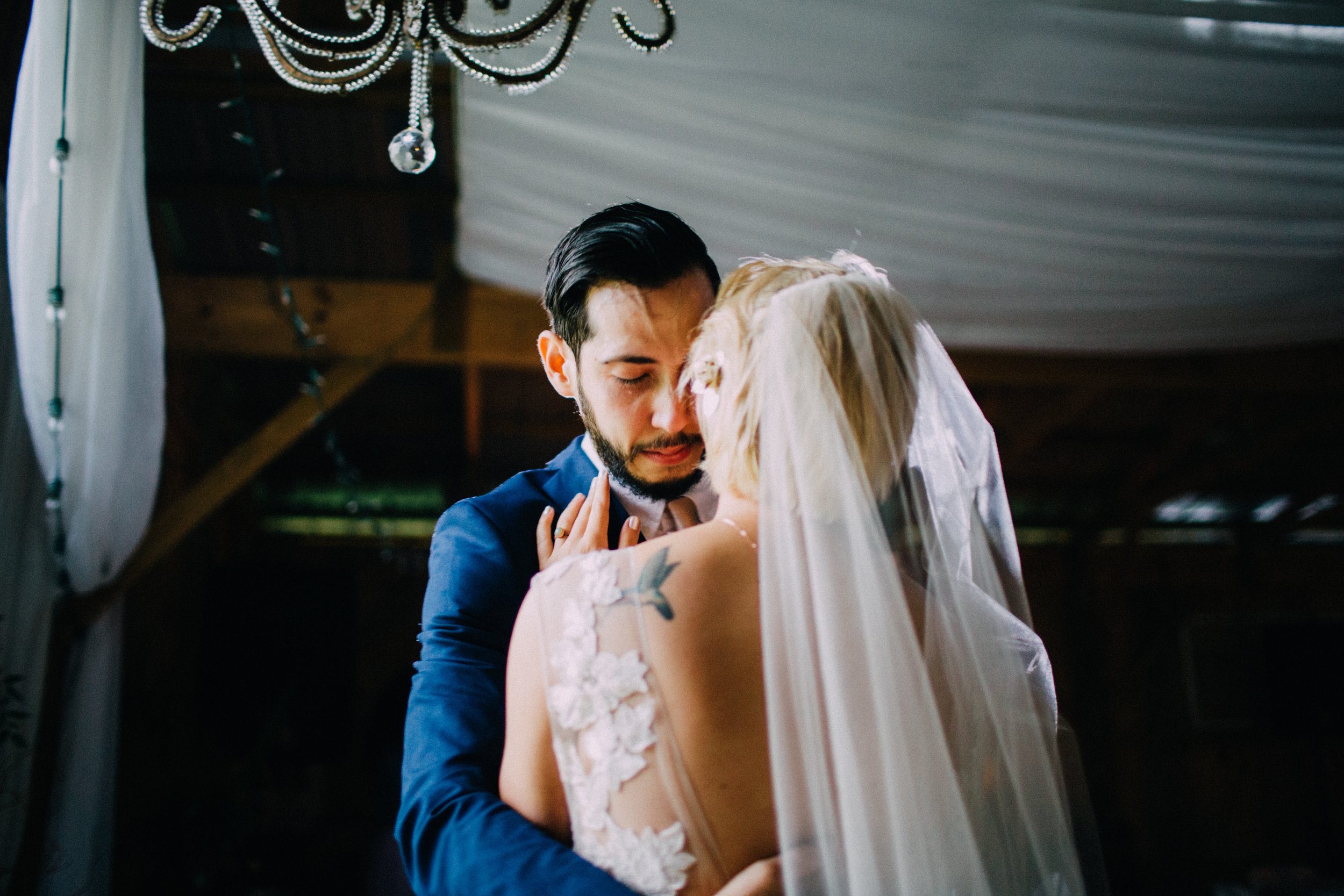 groom sheds a tear during first dance with wife