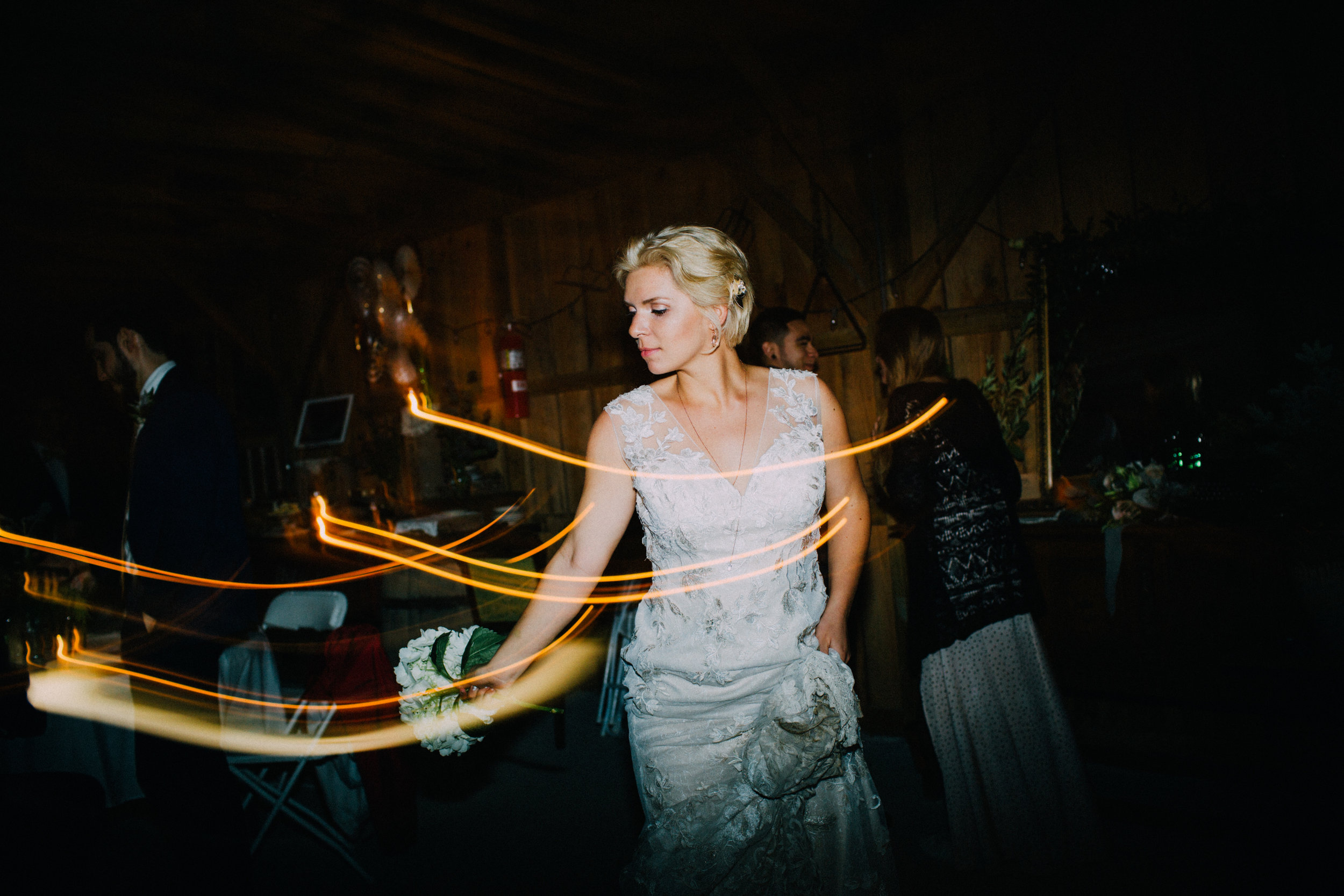 dancing bride bouquet toss at reception