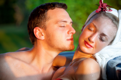 Man sniffing the neck of an attractive woman